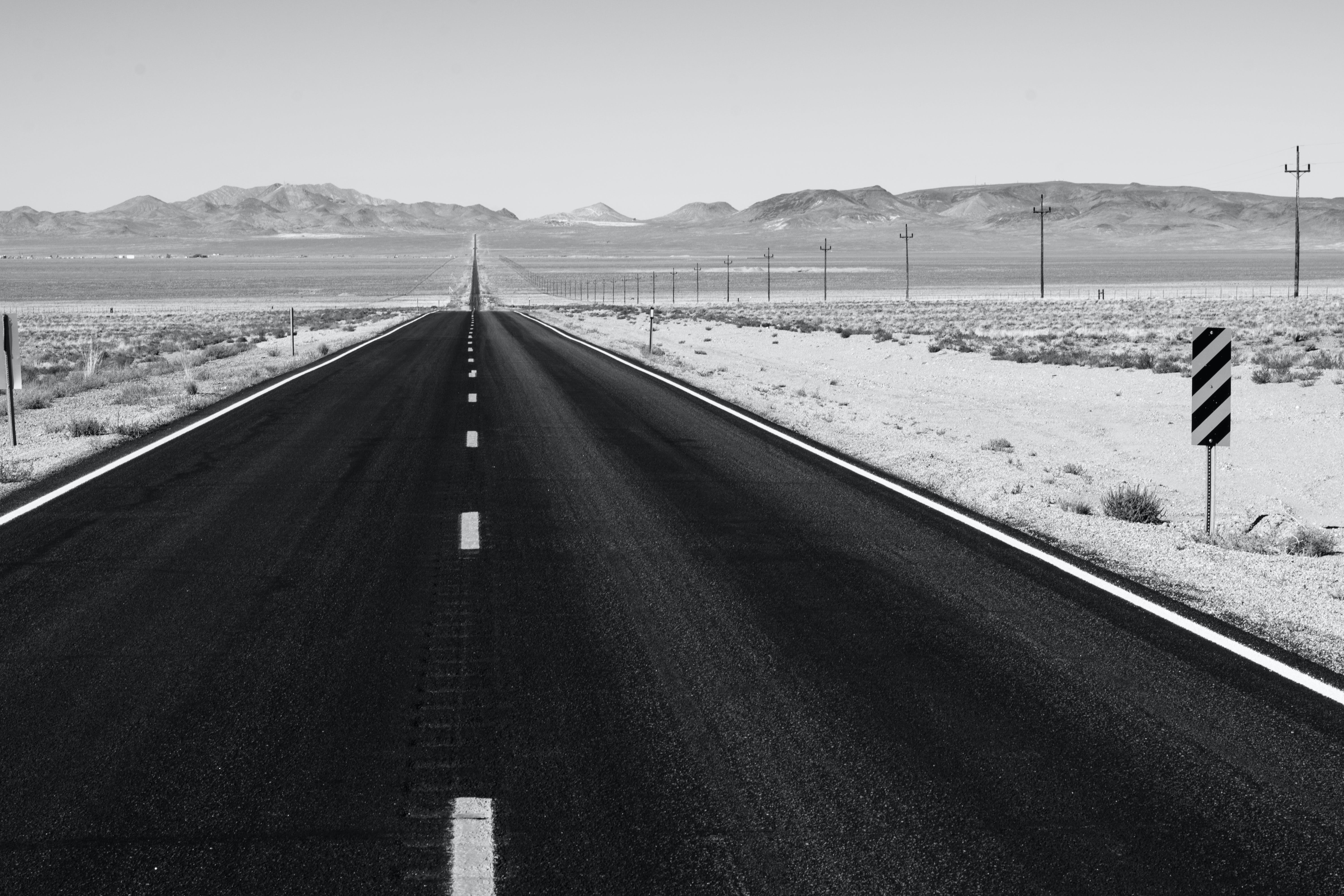 Grayscale Photo of Road on Desert