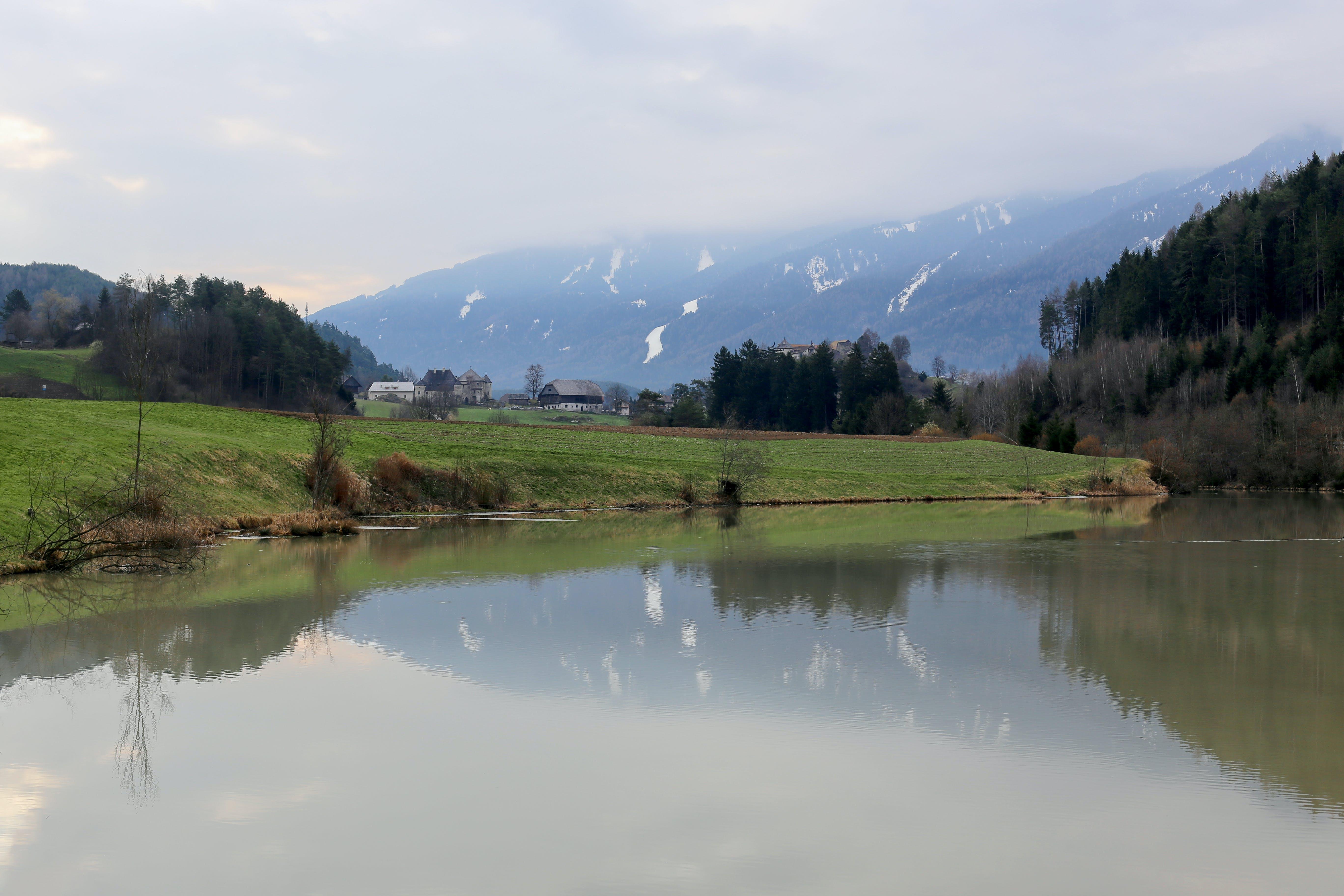 Landscape Photography of Green Grass Field Near River