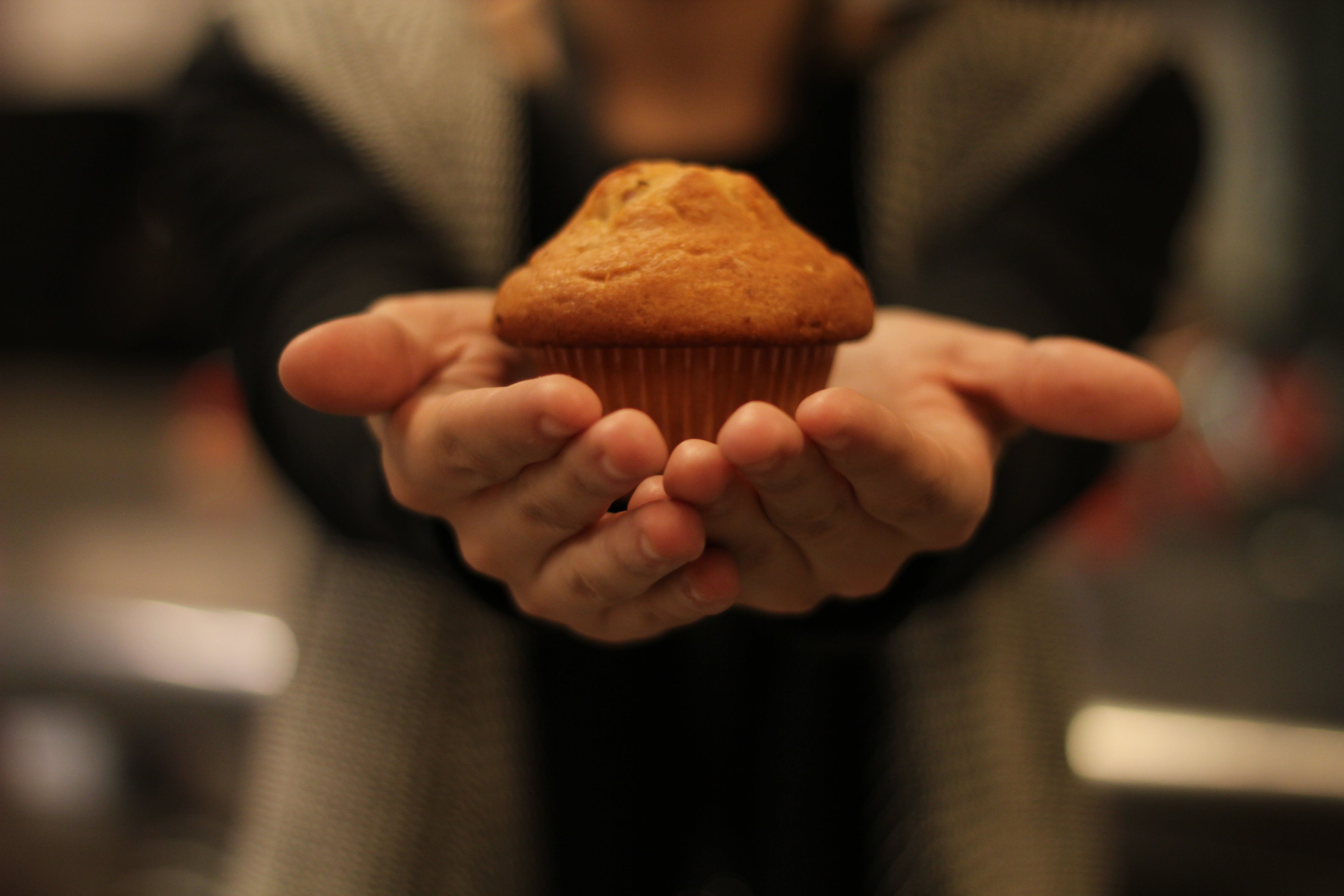 Person's Hand With Cupcake