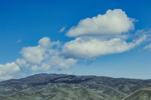 Mountains Under Blue Sky And Clouds
