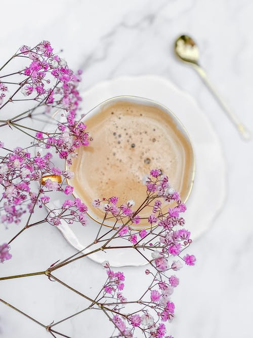 Overhead View of PinkGypsophila and Coffee Cup