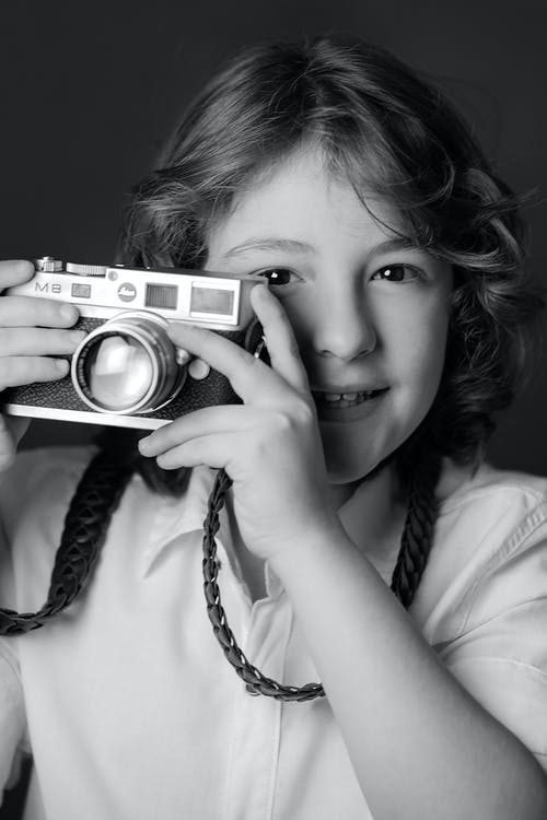 Black and White Picture of Girl with Camera