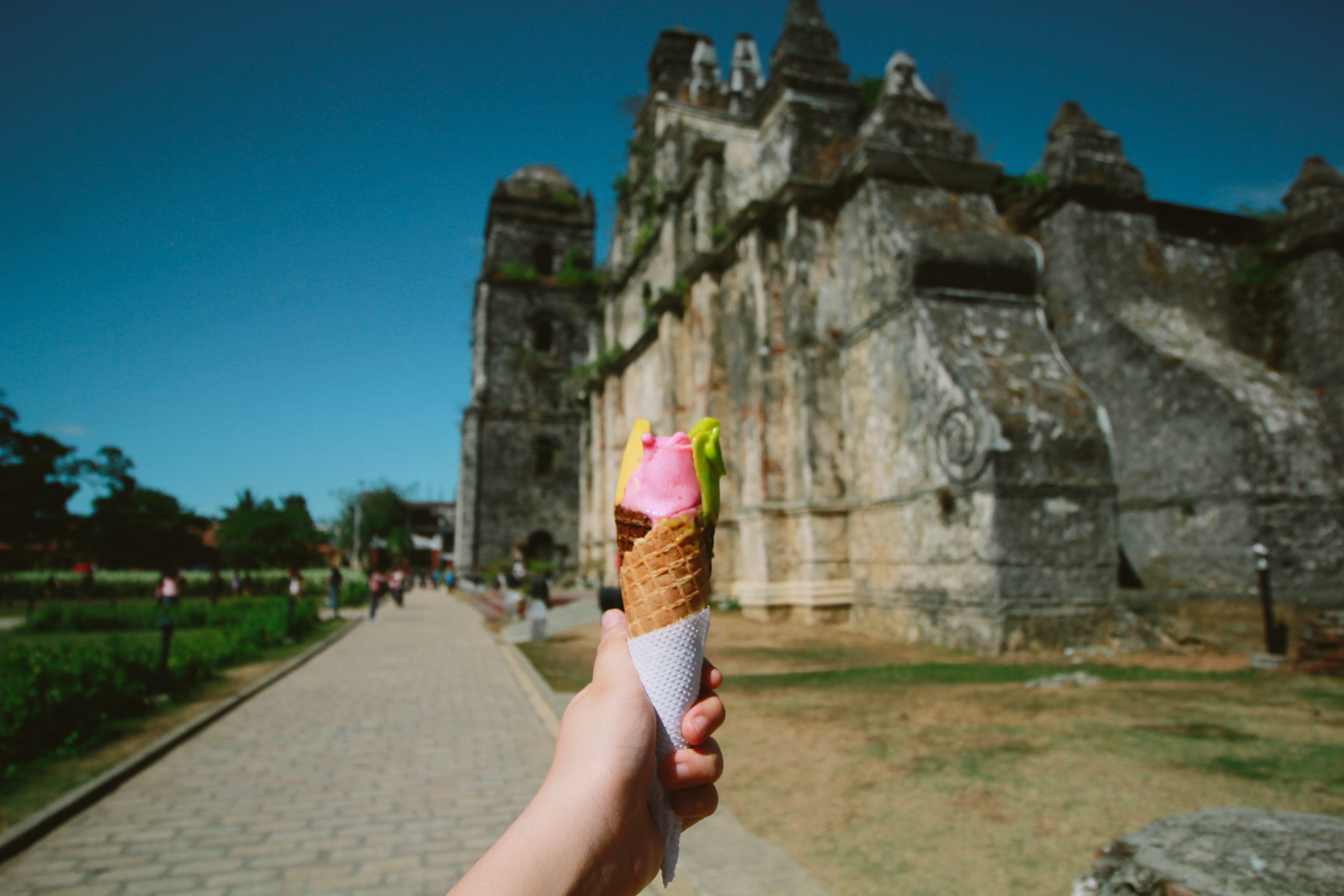 Person Holding Ice Cream With Cone