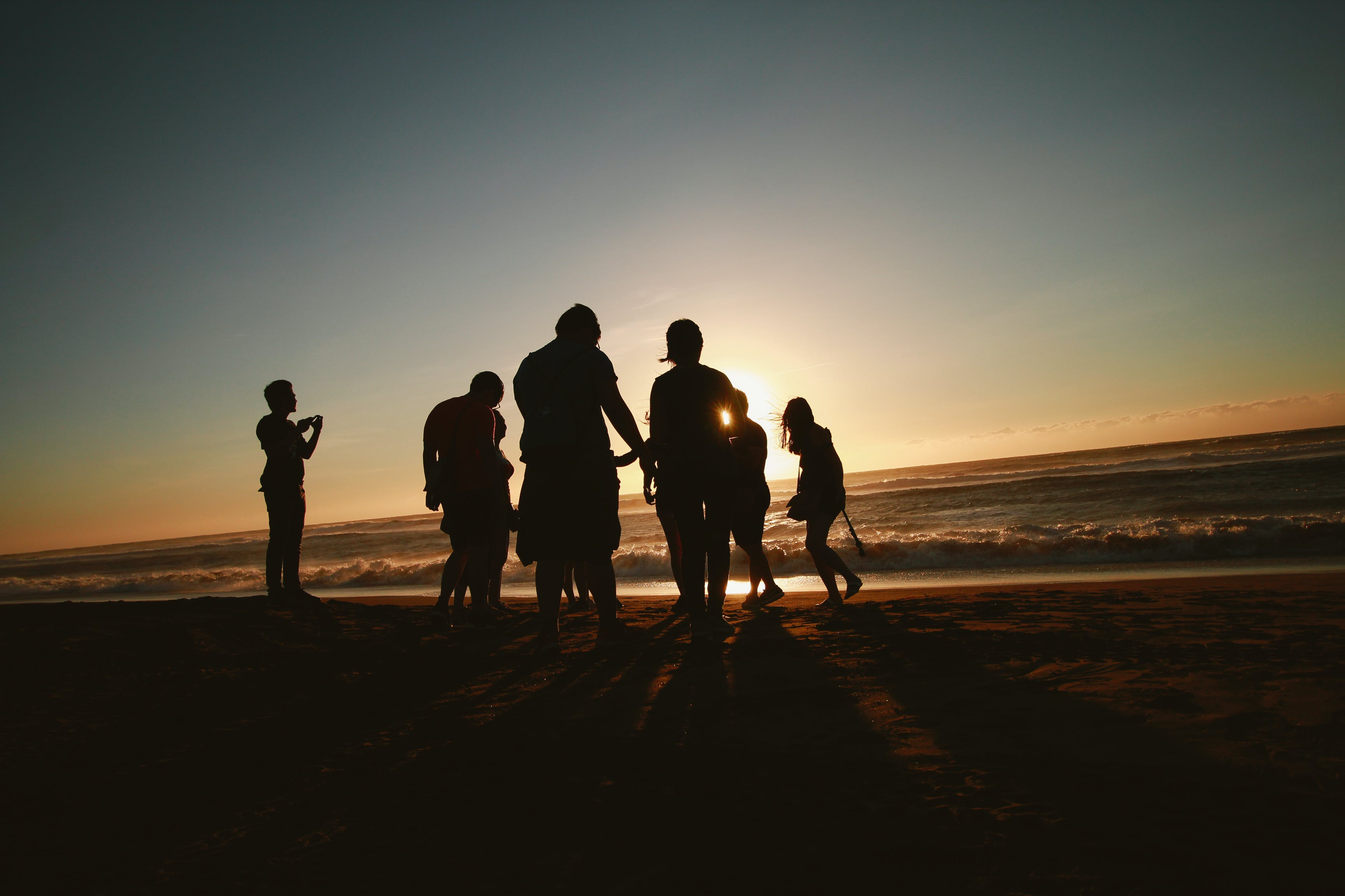 Silhouette Photo of People at the Seashore