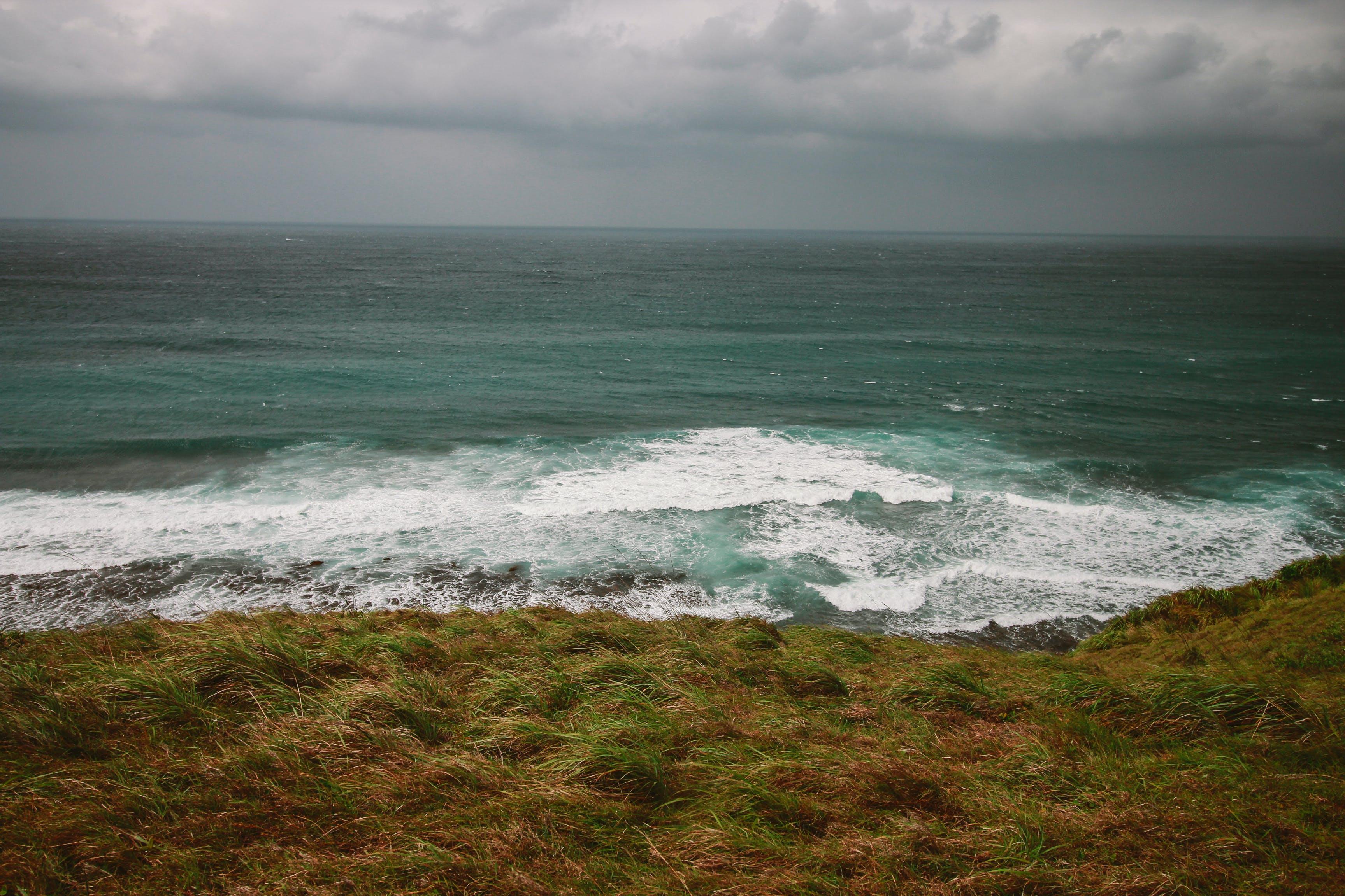 Foto profissional grátis de abismo, água, alvorecer, beira-mar