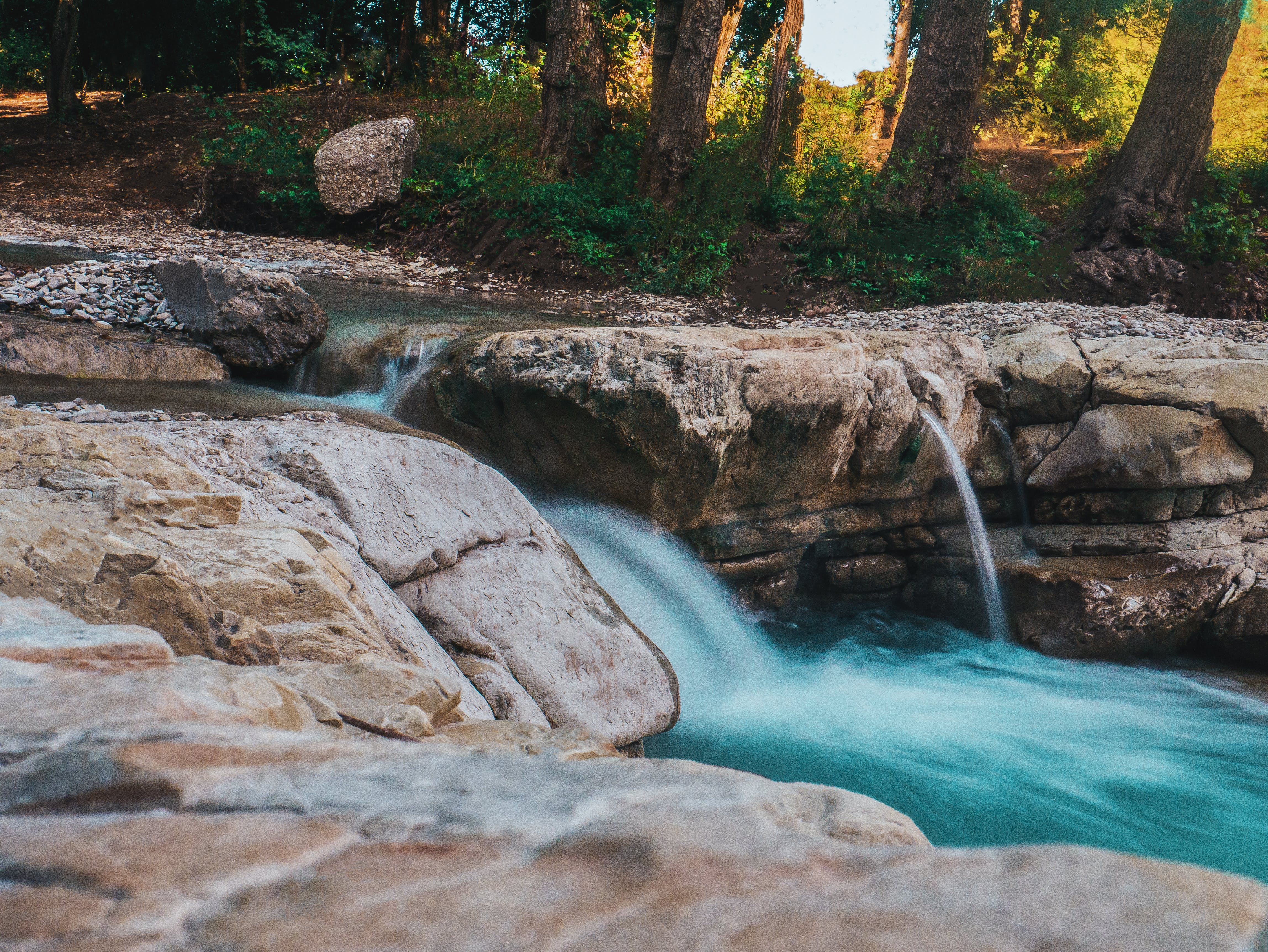 Photography of Water Flow Near Rocks