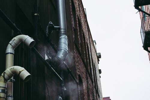 Gray Pipe on Building Wall
