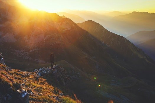 Free stock photo of mountains, person, sun, sunrise