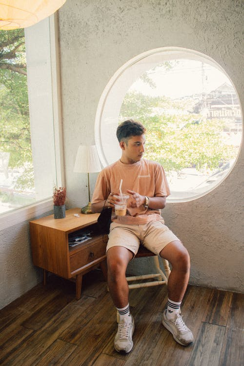 Portrait of Sitting Man Holding Coffee