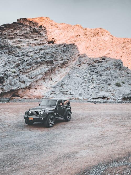Black Jeep Wrangler on Brown Dirt Road