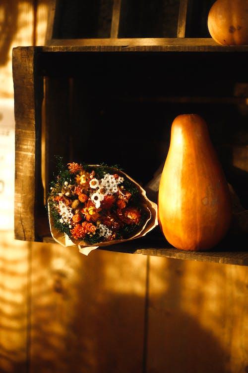 Autumn Still Life of Pumpkin and Bunch of DriedStrawflowersin Wooden Crate