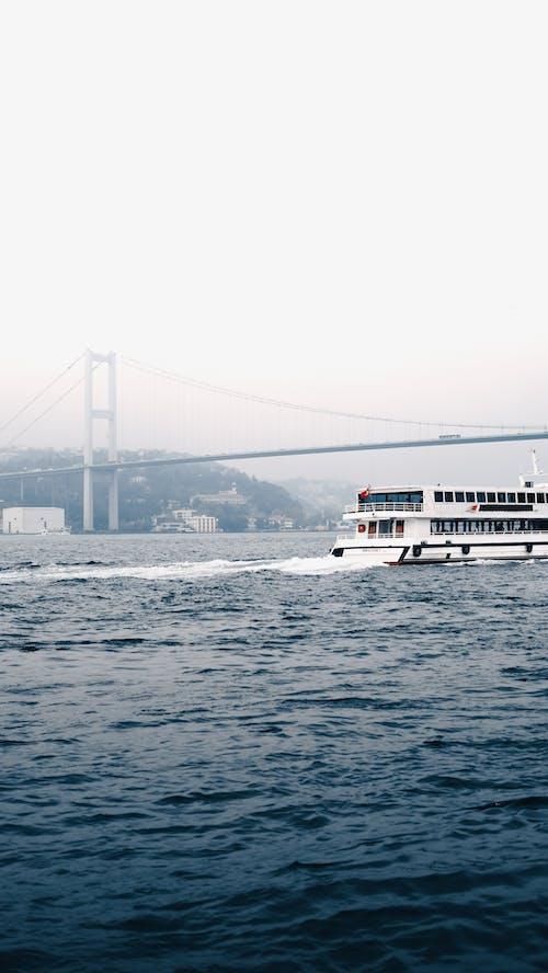 White Boat on Sea Near Bridge
