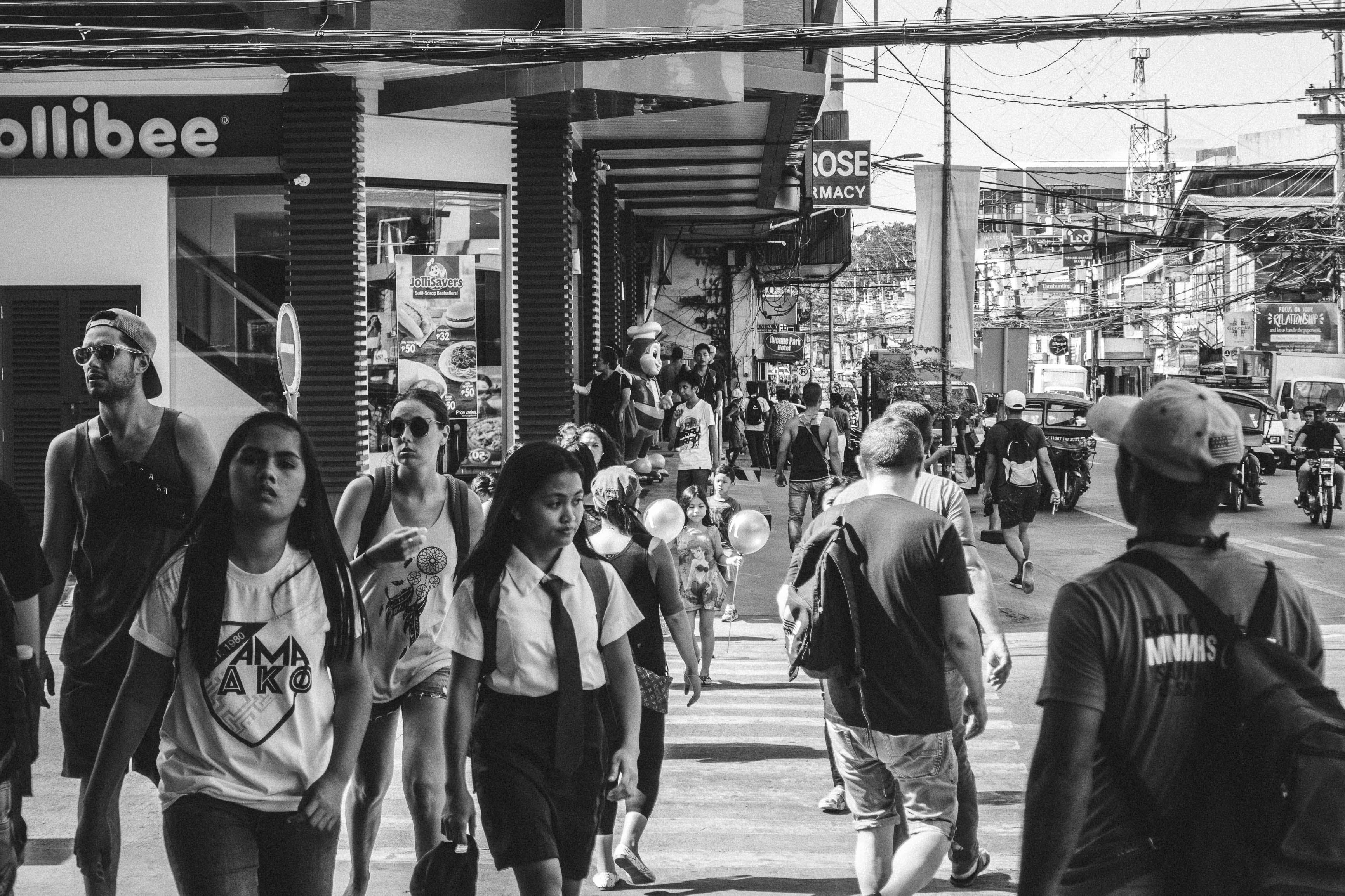 Grayscale Photo of People Walking in the Street