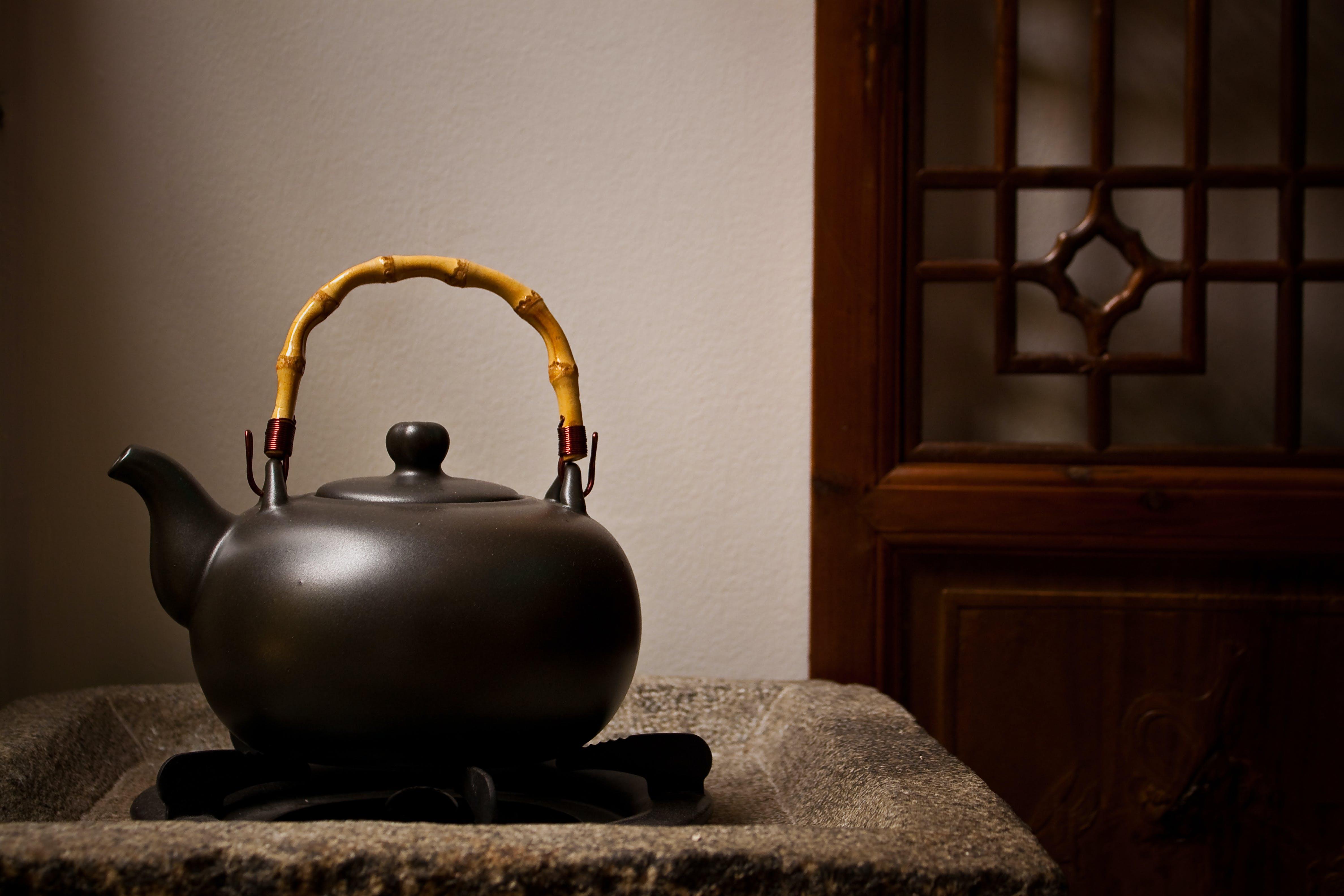Unused Teapot on Side Table