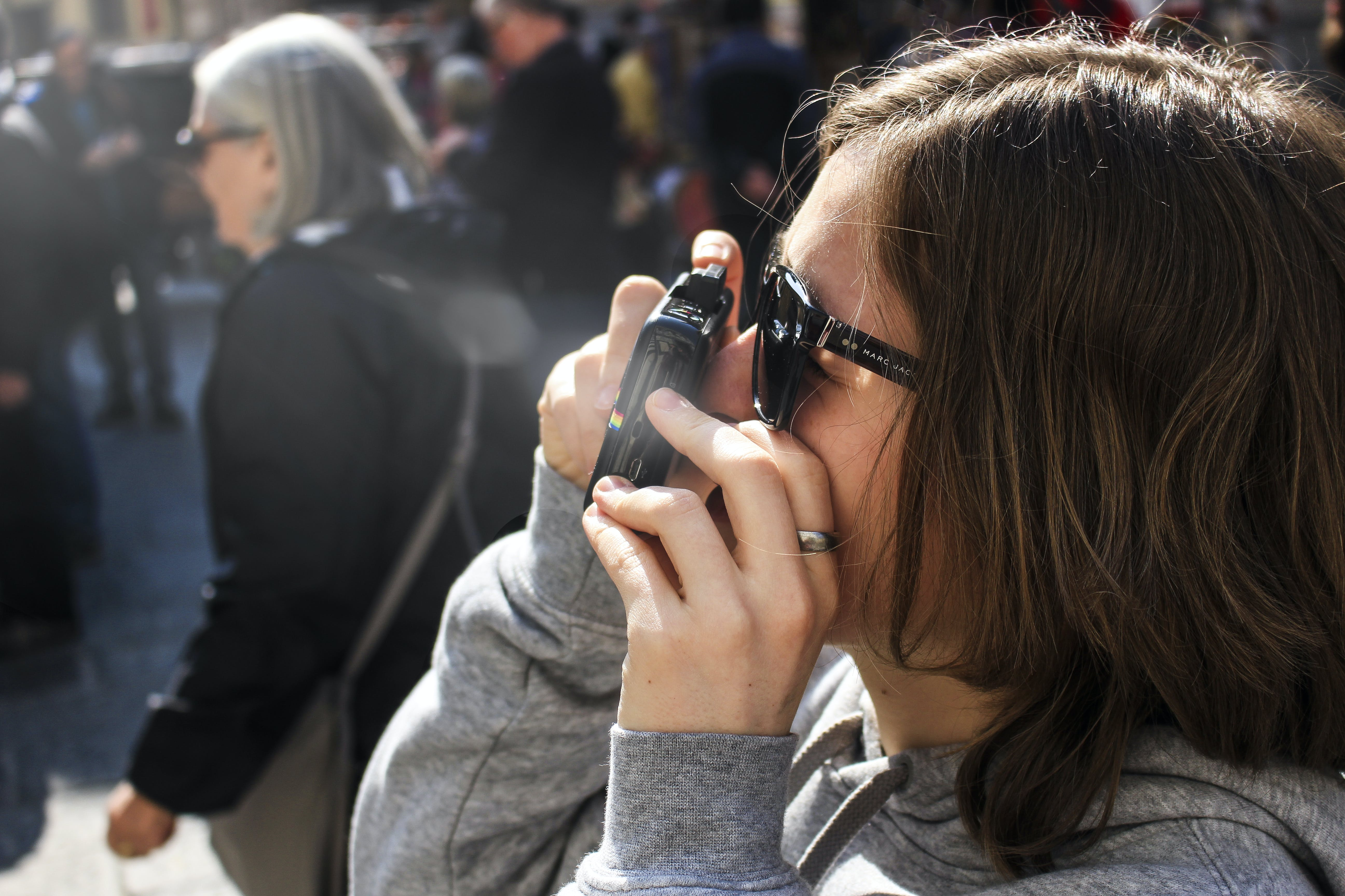 Woman Holding Point-and-shoot Camera With Gray Jacket