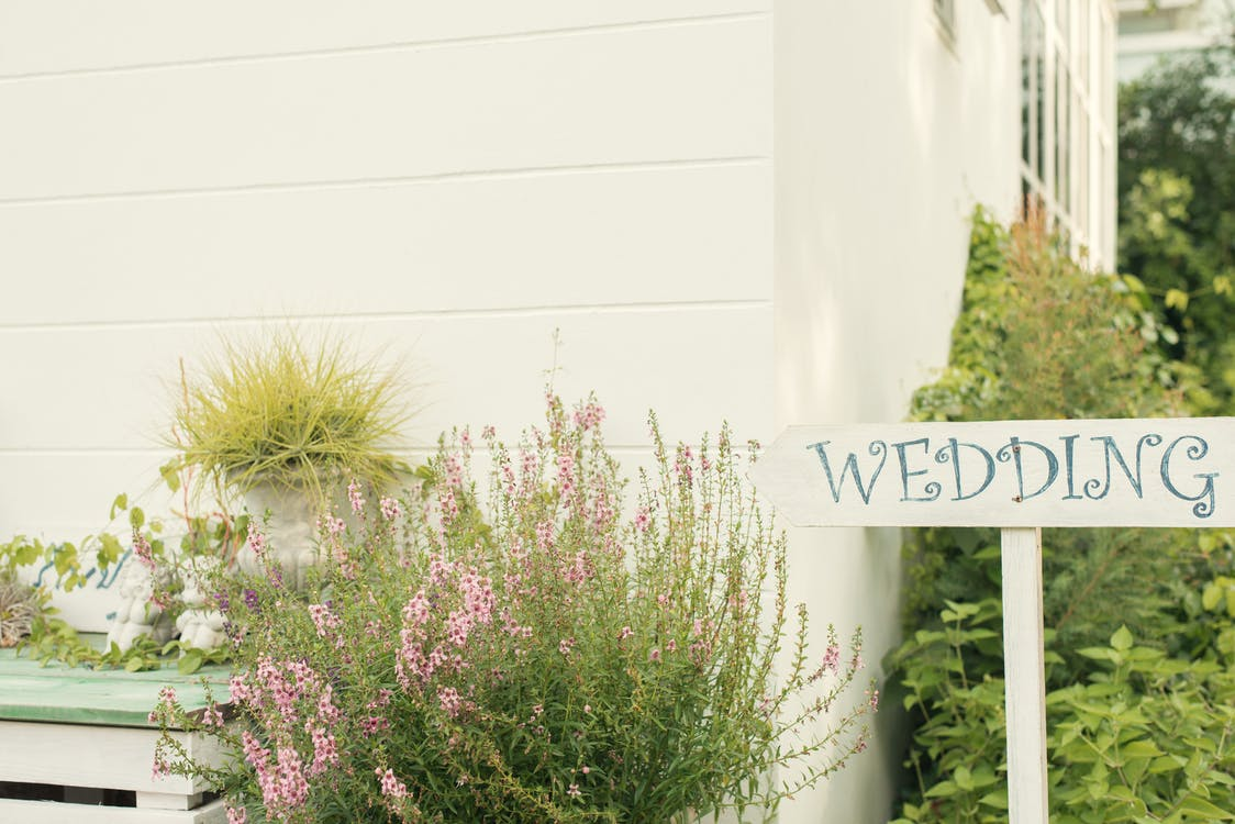 Wedding Sign Near House With Green Plants