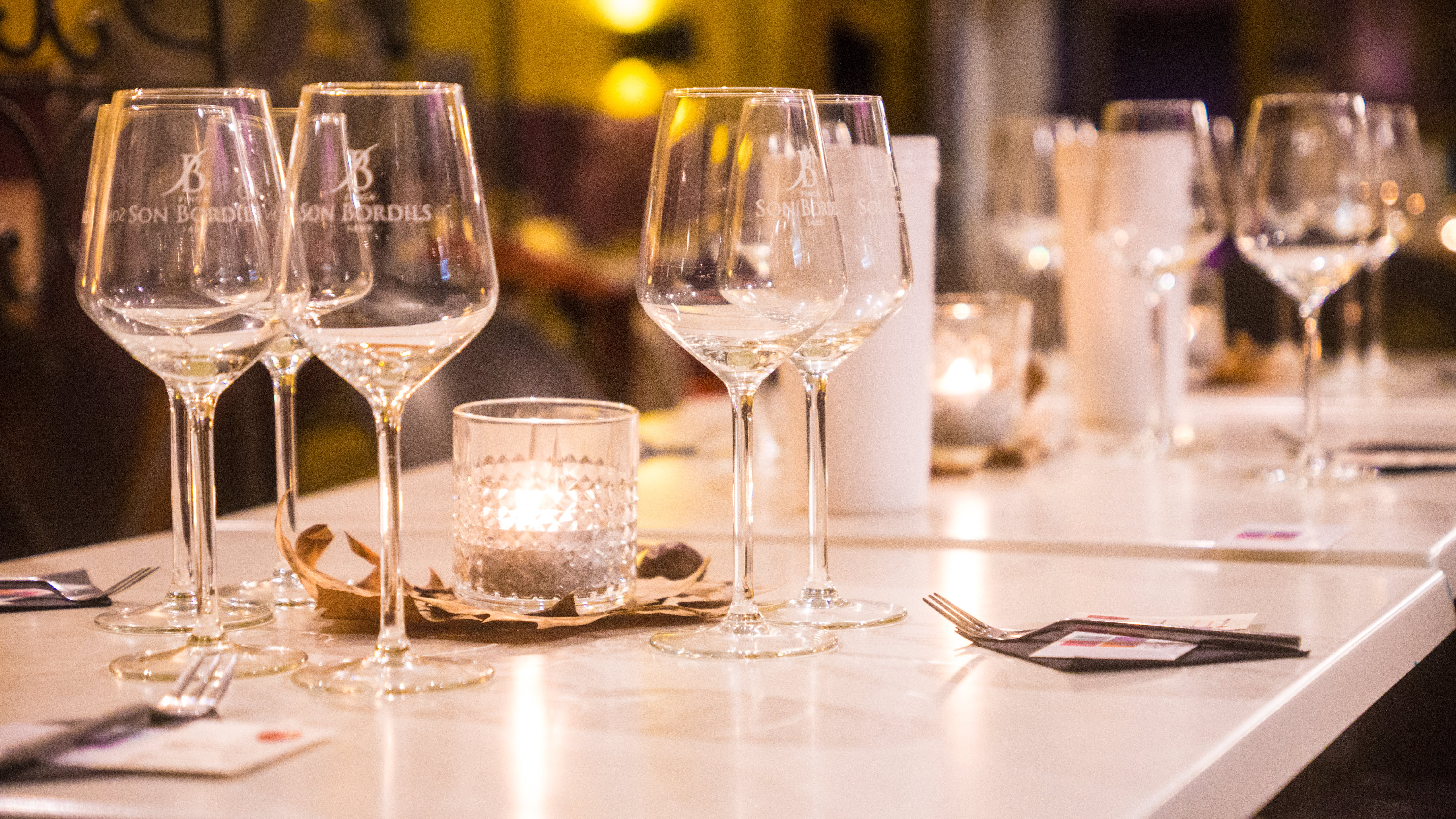 Clear Wine Glasses on White Wooden Table