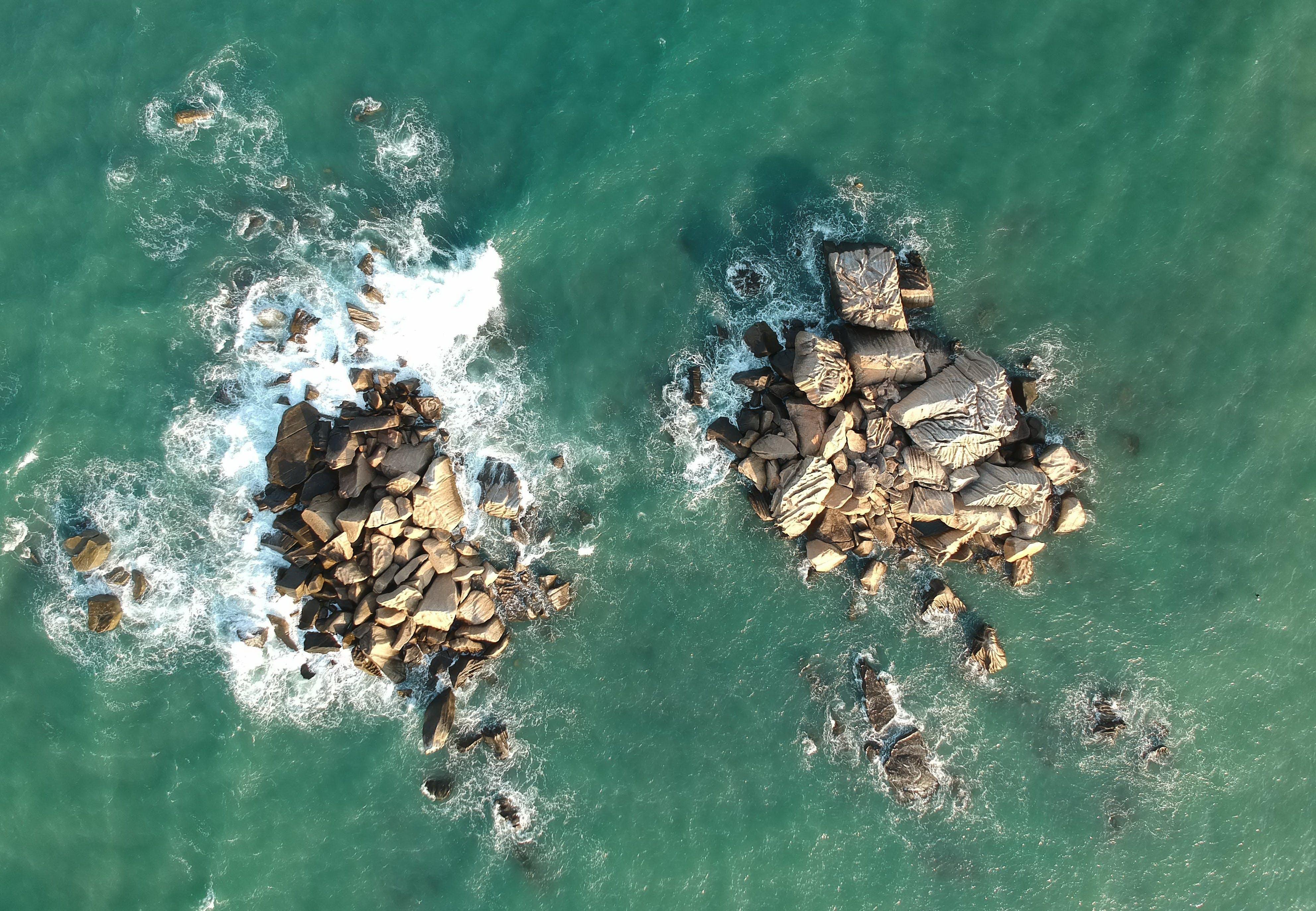 Bird's Eye View of Rocks In Ocean