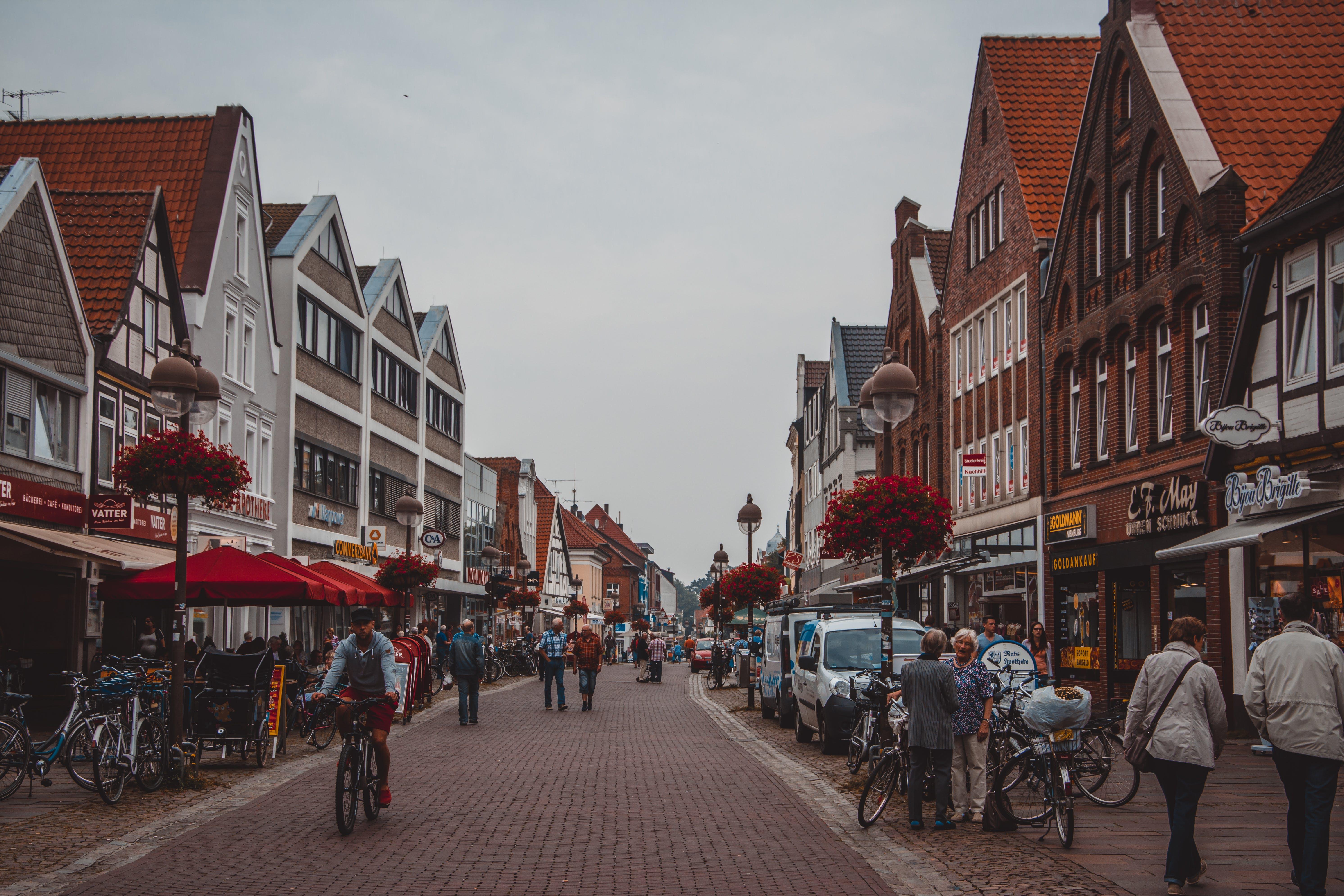 People Walking on Road Beside Buildings