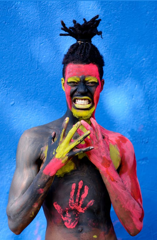 Man Painted With Red and Yellow Paint