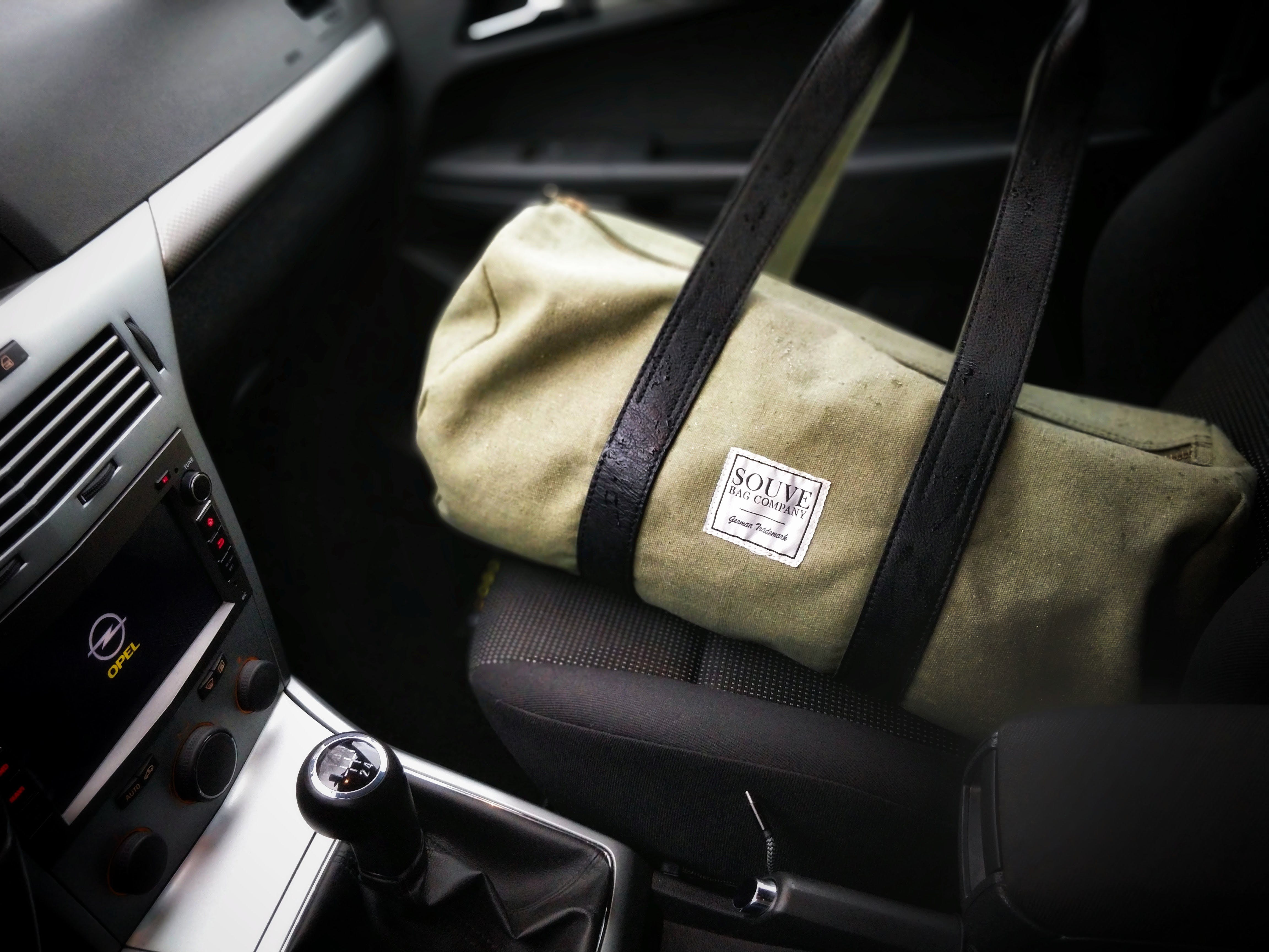 Brown and Black Duffel Bag on a Car Seat