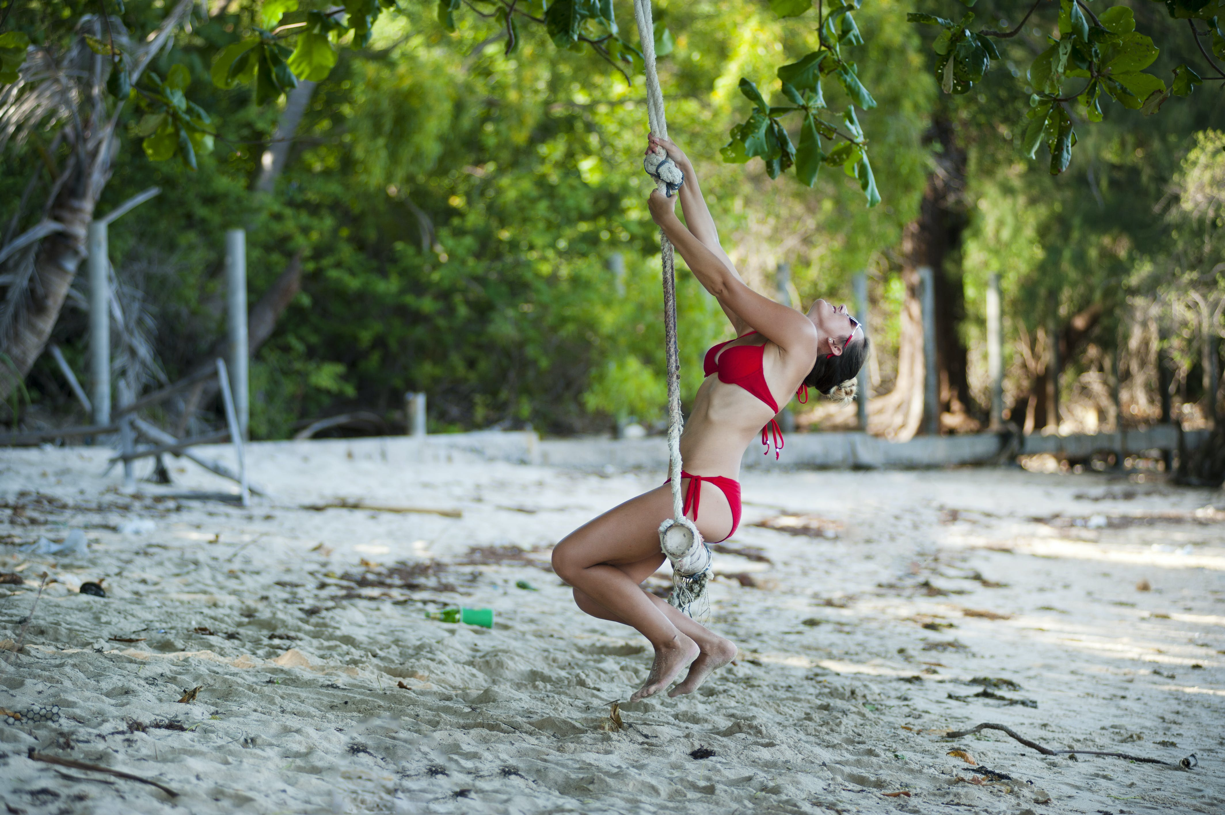Woman Wearing Red Bikini Swinging