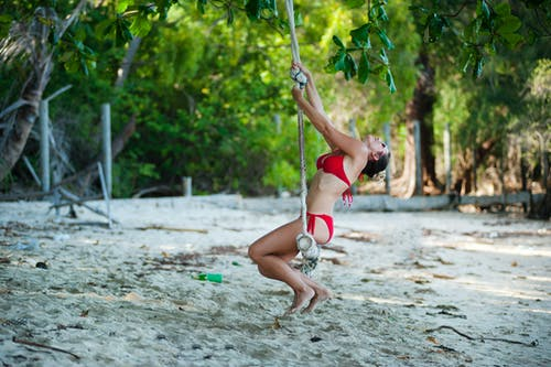 Woman Wearing Red Bikini Swinging