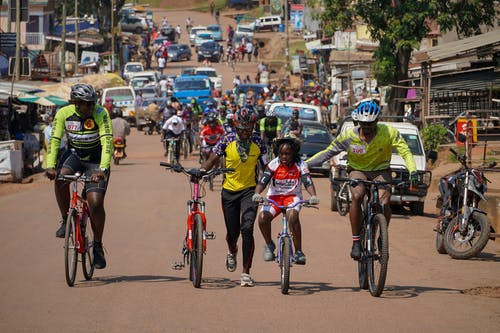 People Riding Bicycles on Road