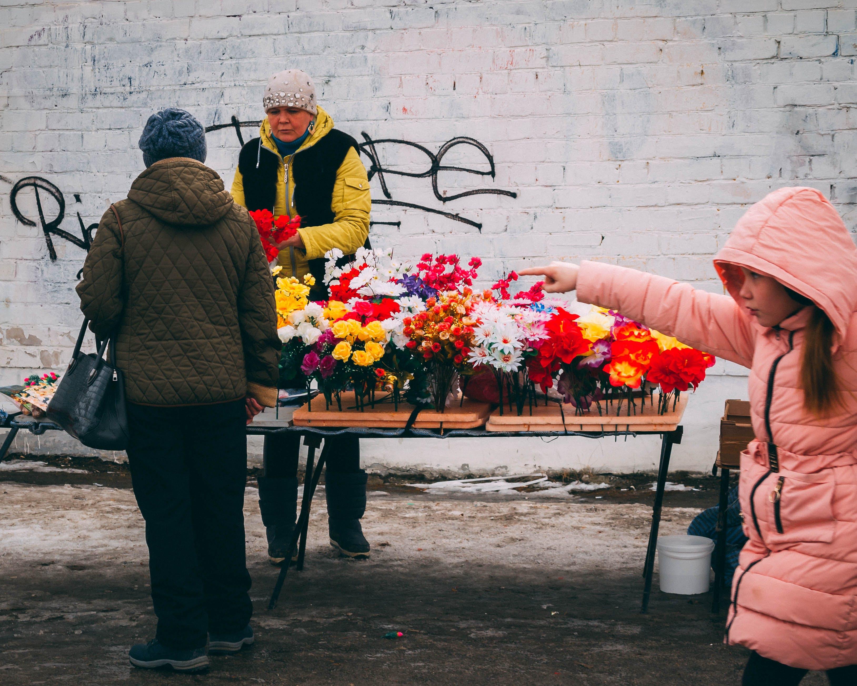 Woman in Pink Full-zip Hoodie Holding Multicolored Flowers