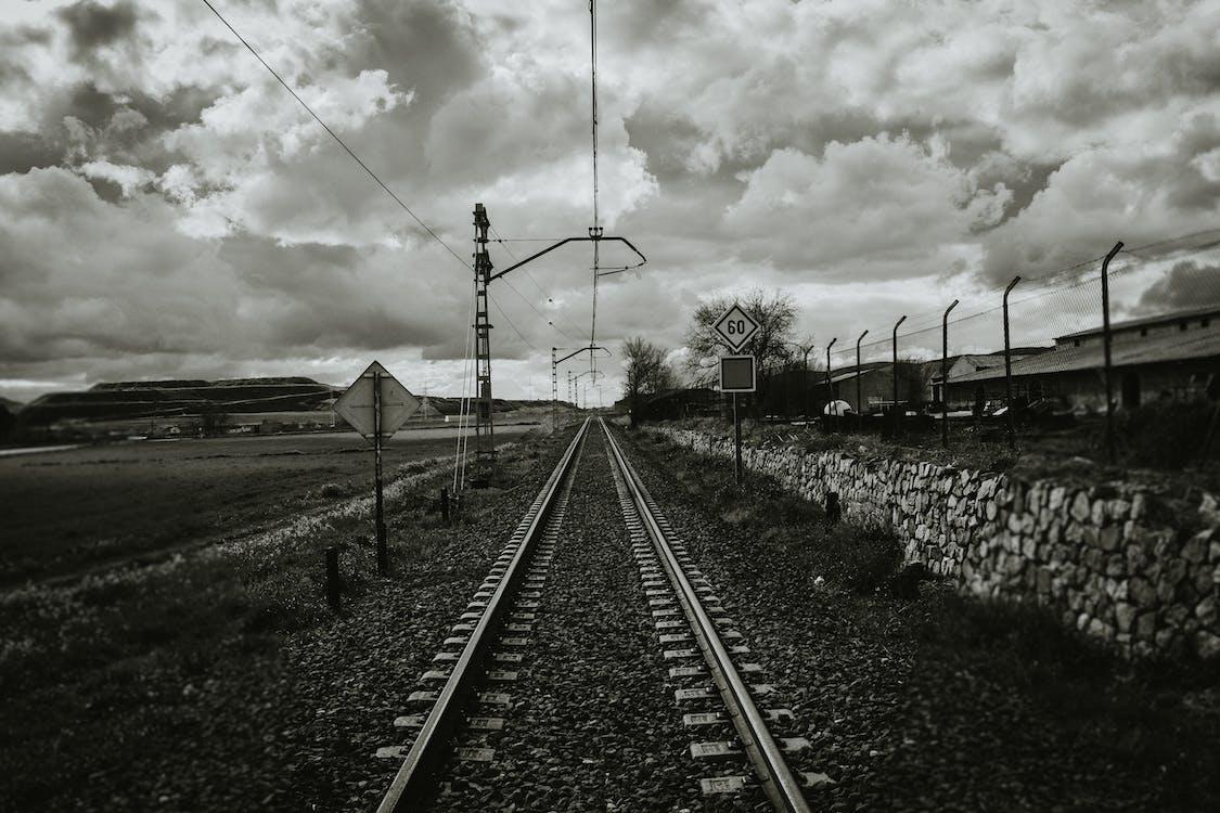 Grayscale Photograph of Train Rail