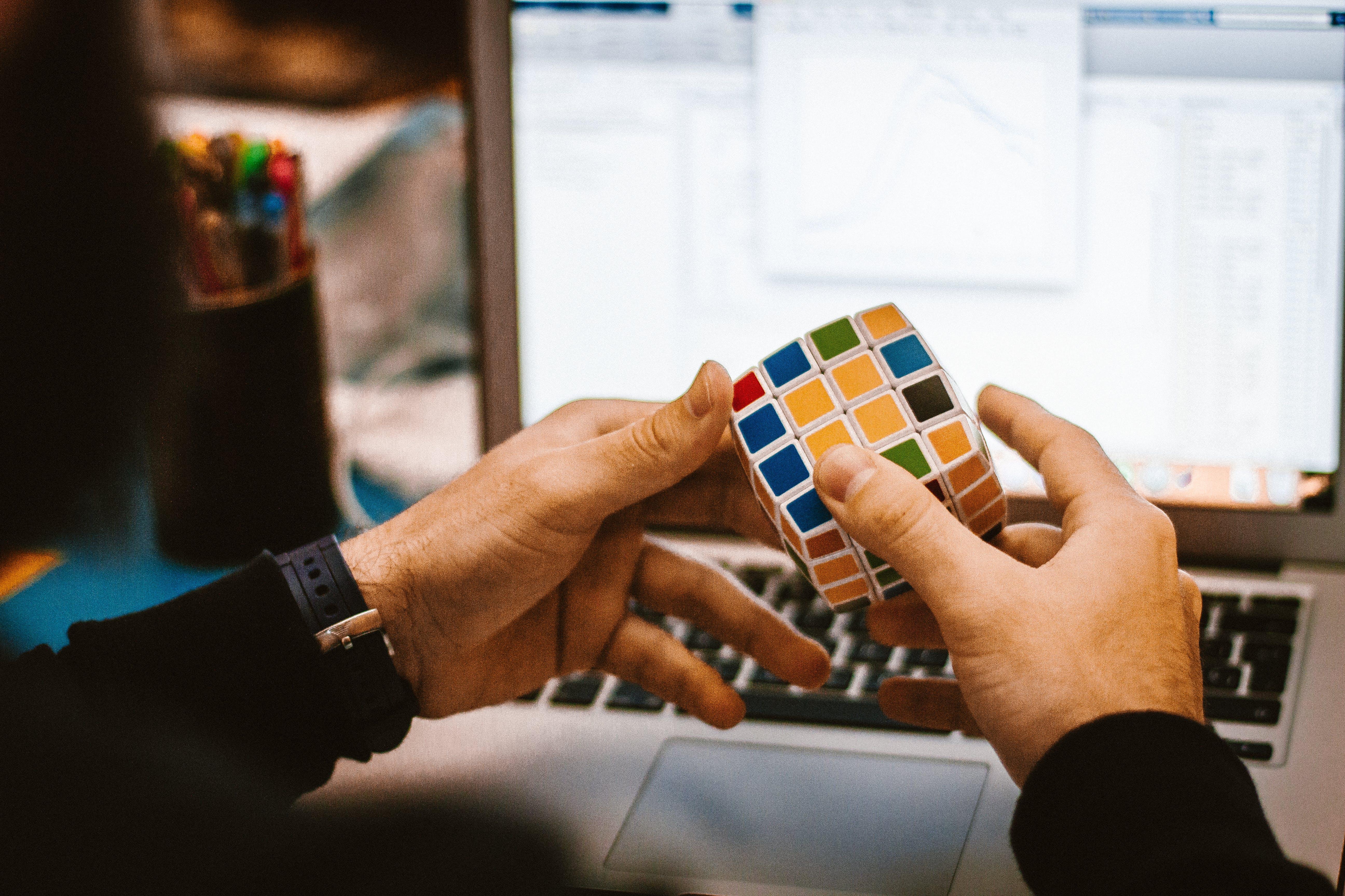 4x4 Rubik's Cube on a Man's Hand