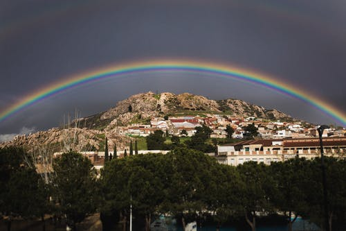 Landscape Photo of the View of City With Rainbow Above