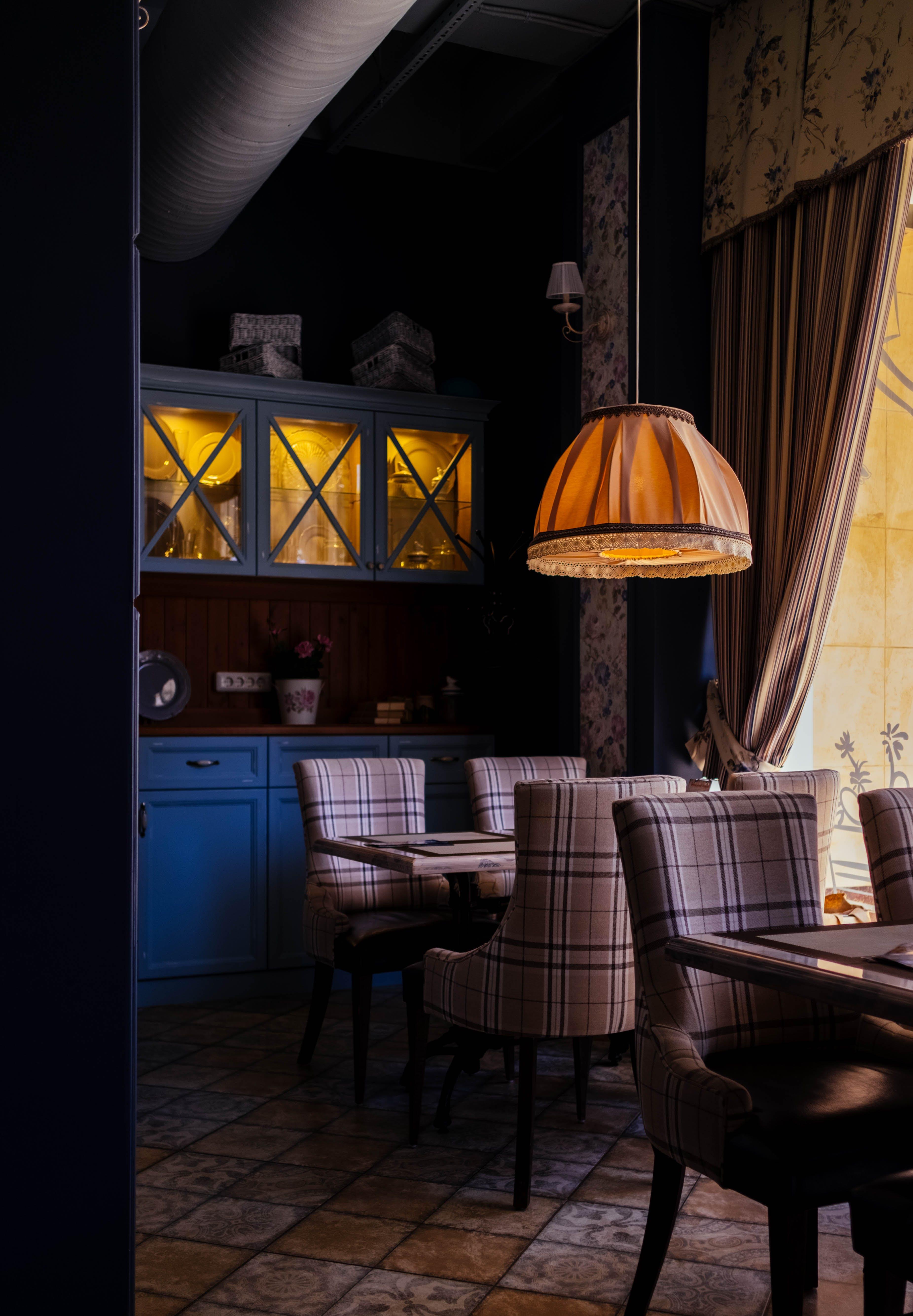 Photo of Room With Orange Pendant Lamp