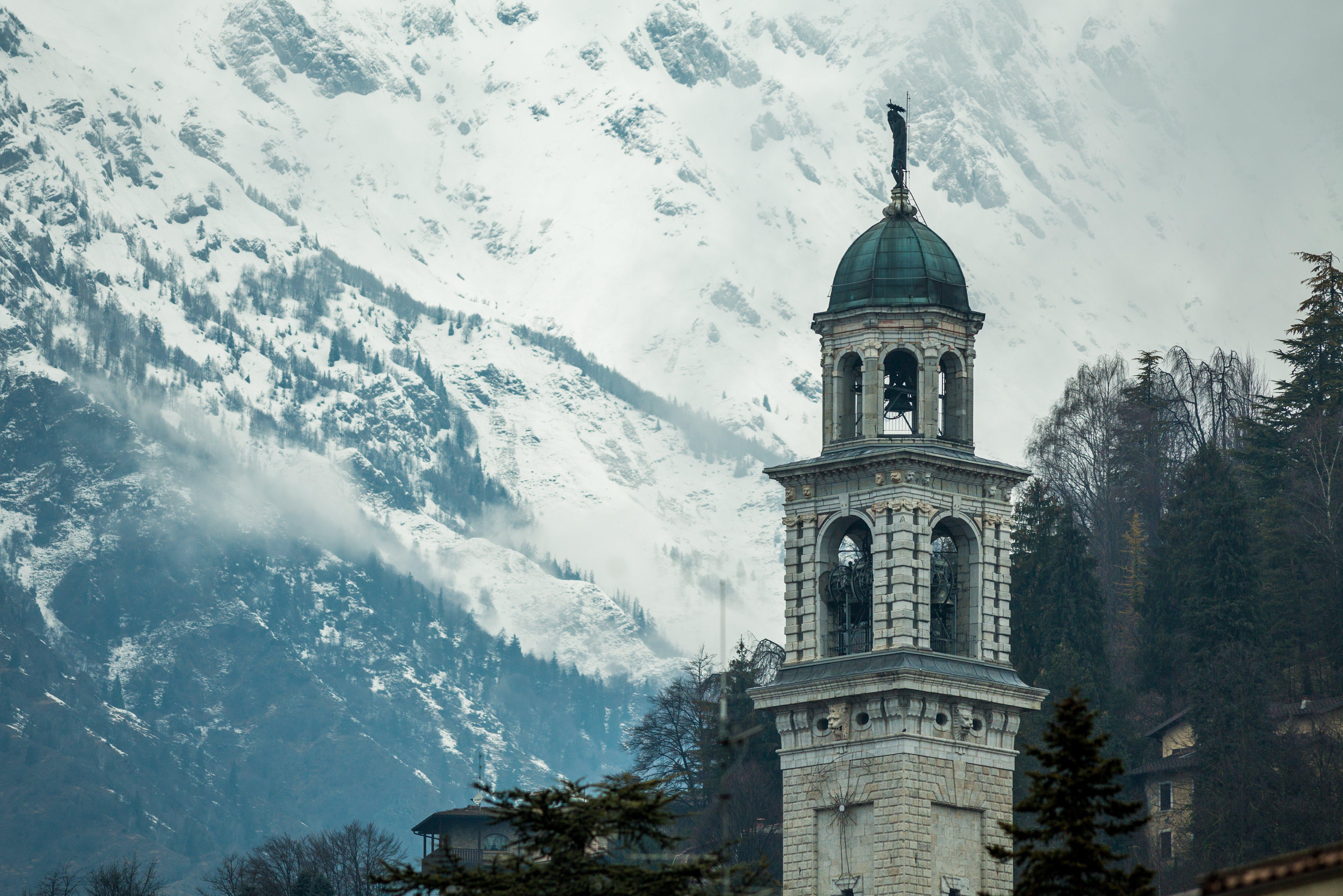 White Concrete Tower Near Mountain