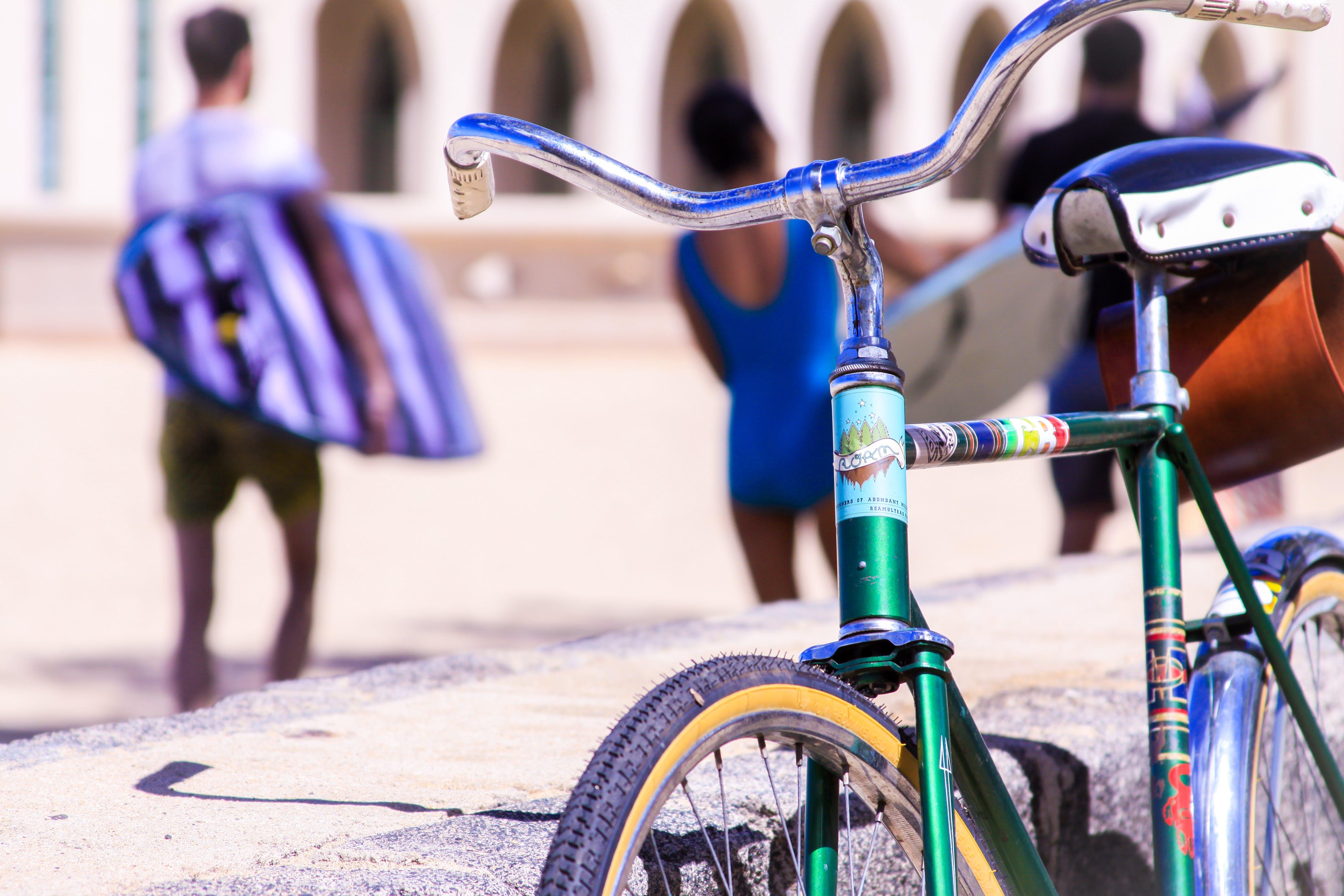 Selective Focus Photography of Green Bike