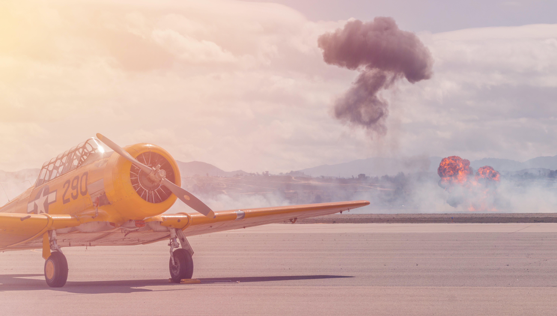 Yellow Biplane on Runway