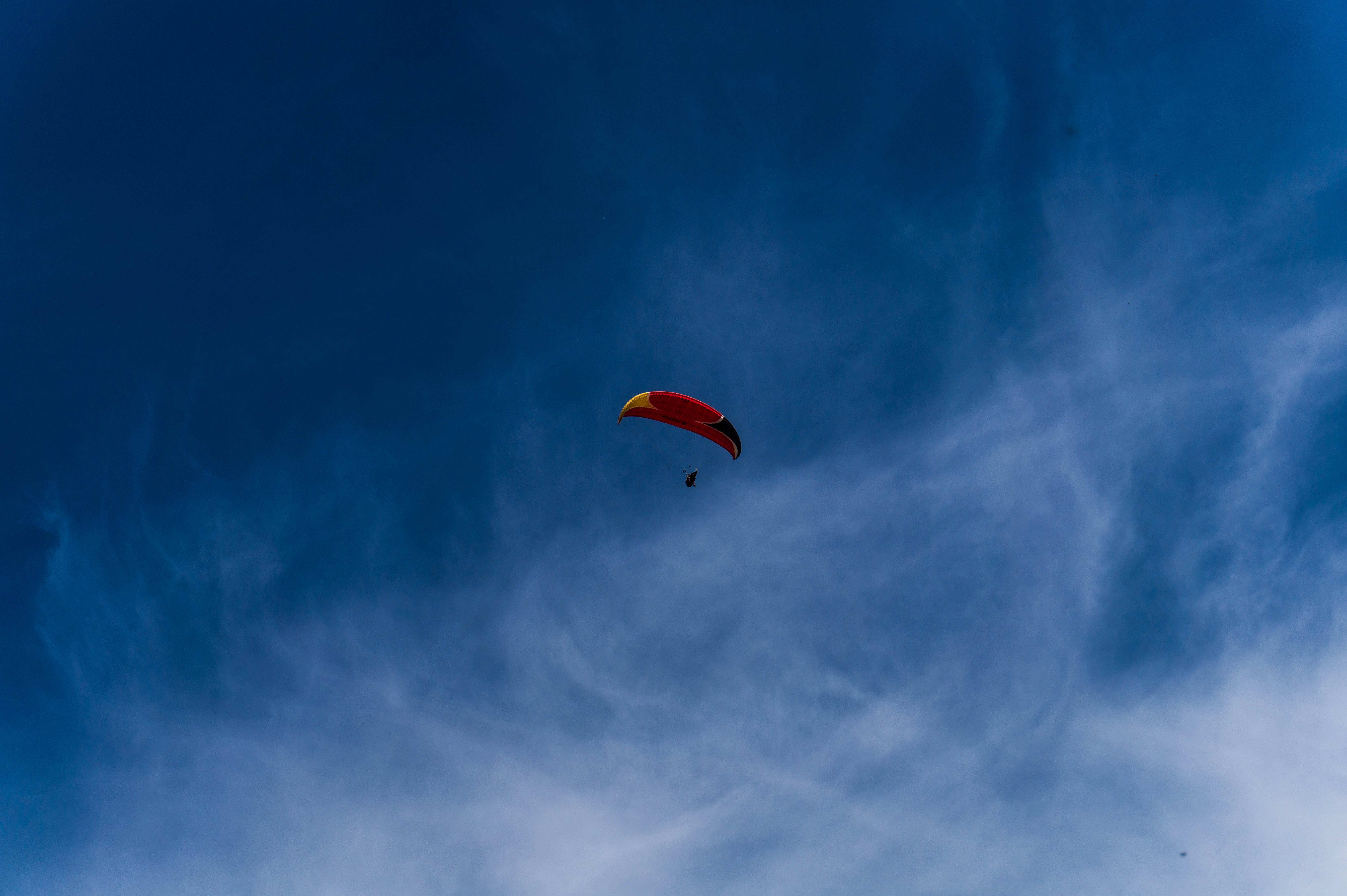 Person On Parachute Flying In The Sky