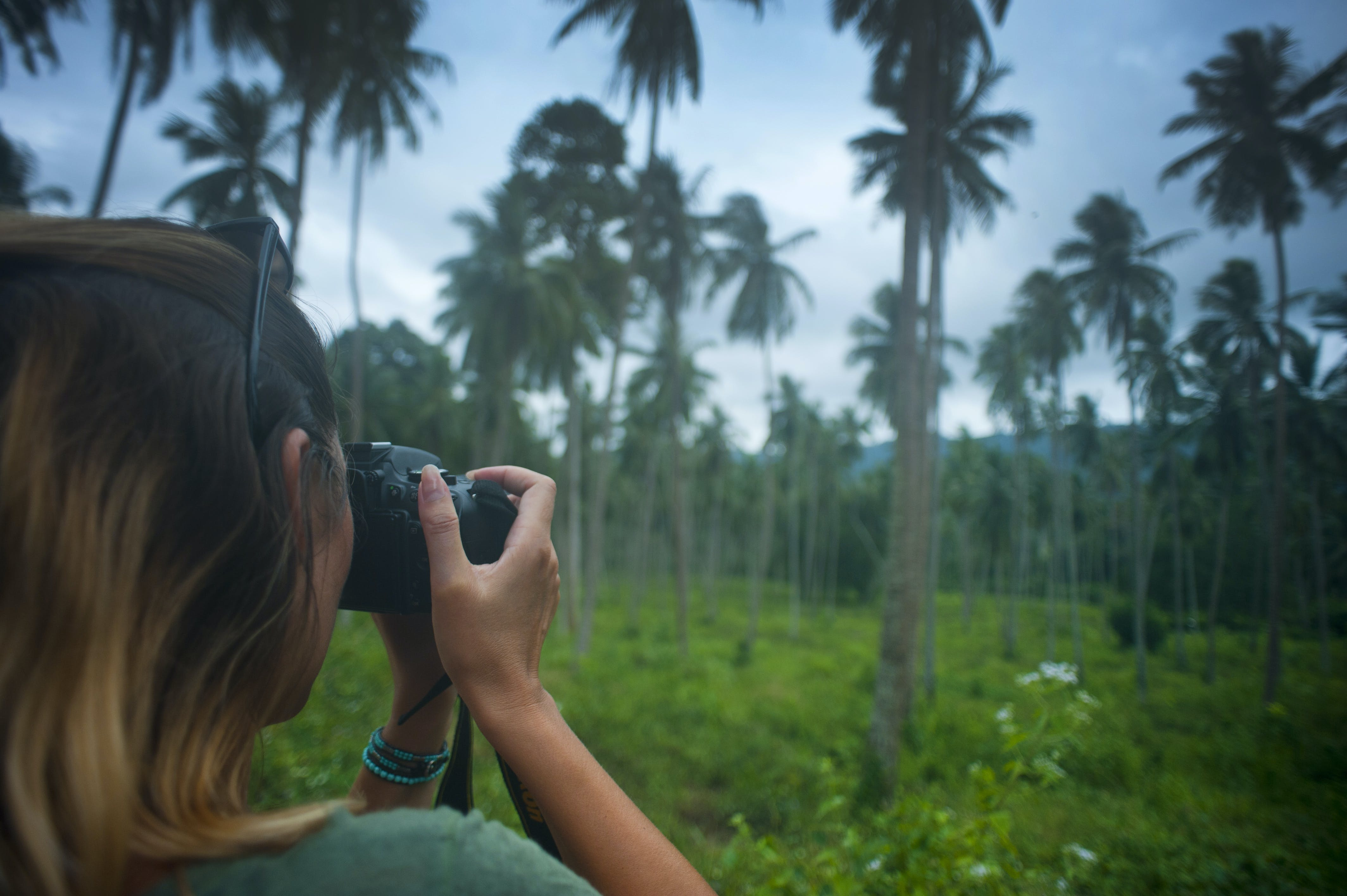 Woman Holding Dslr Camera Taking Photo