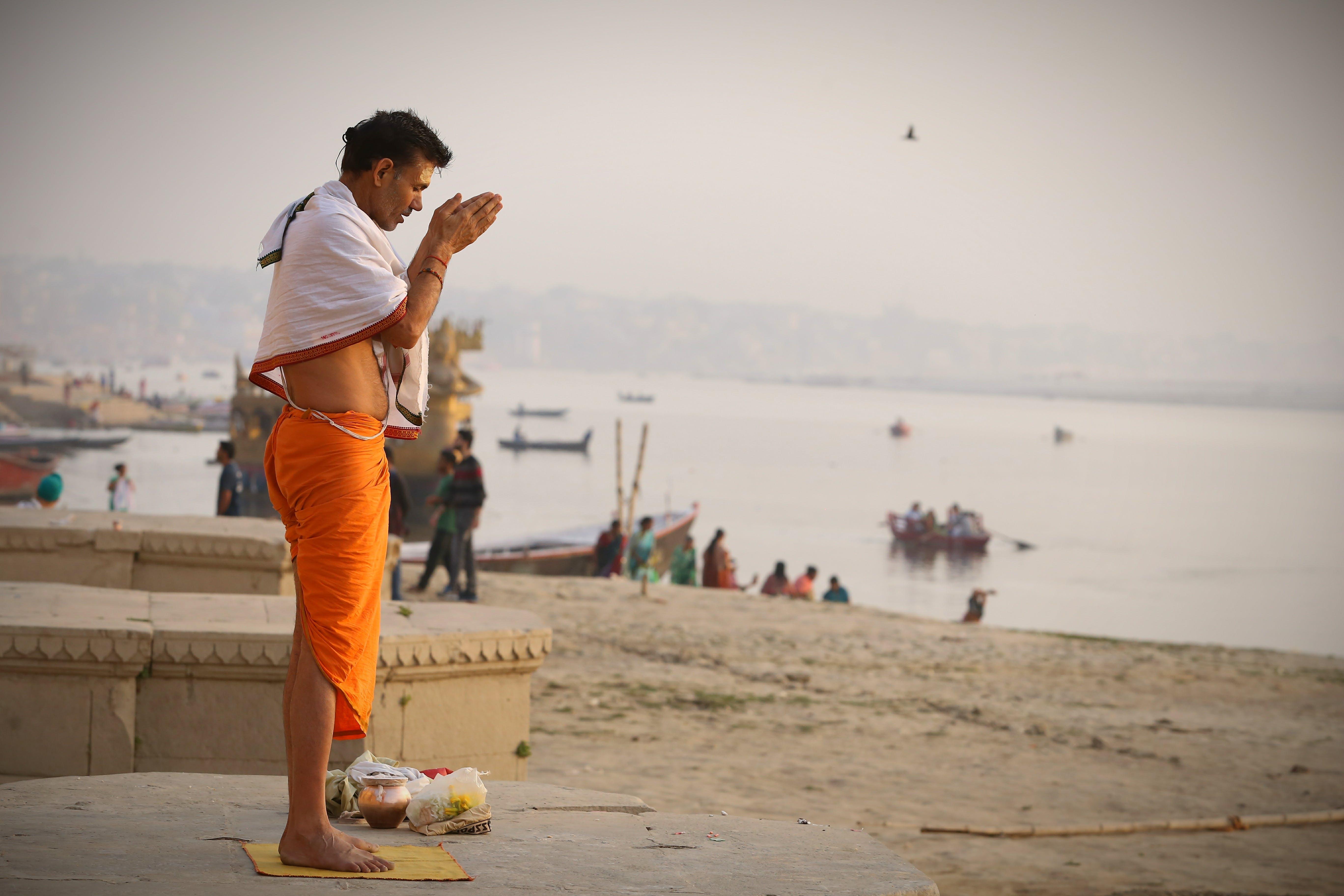 Man Meditating On Seashore
