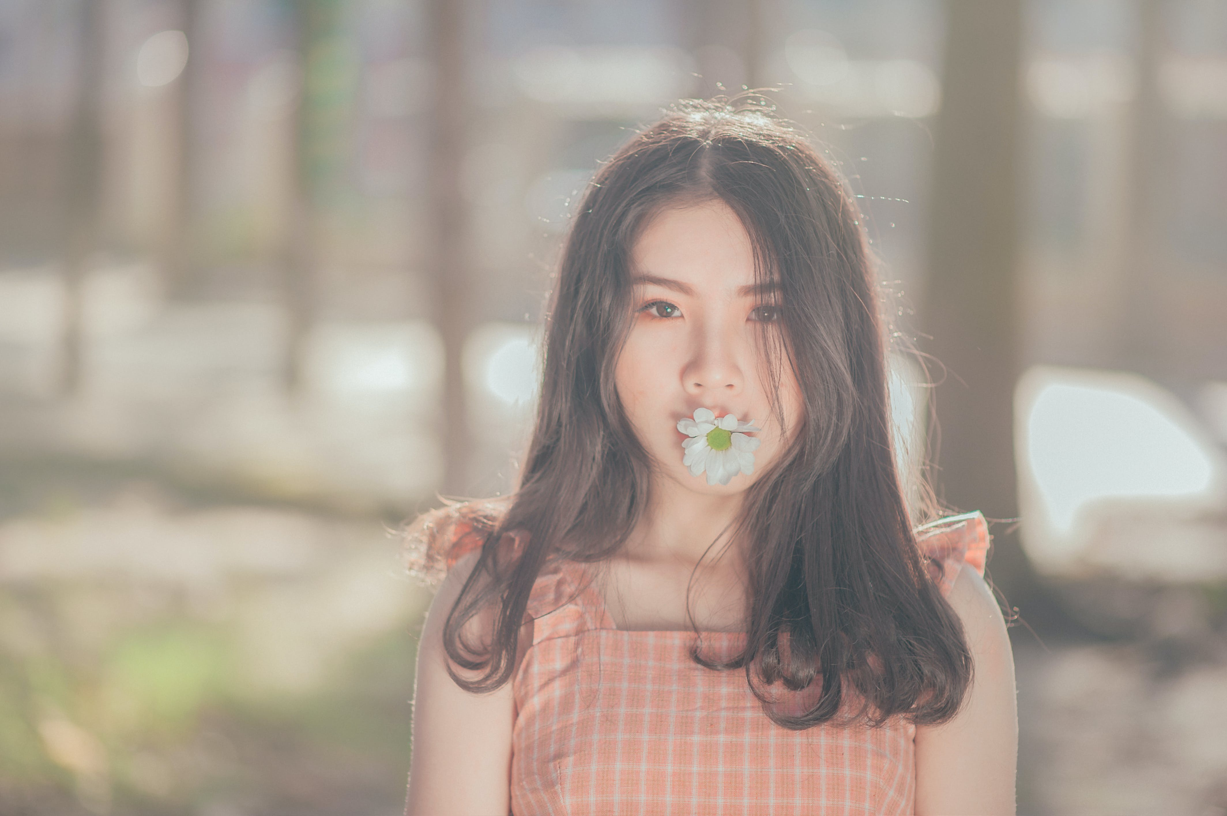 Photo of Woman with Flower on her Mouth