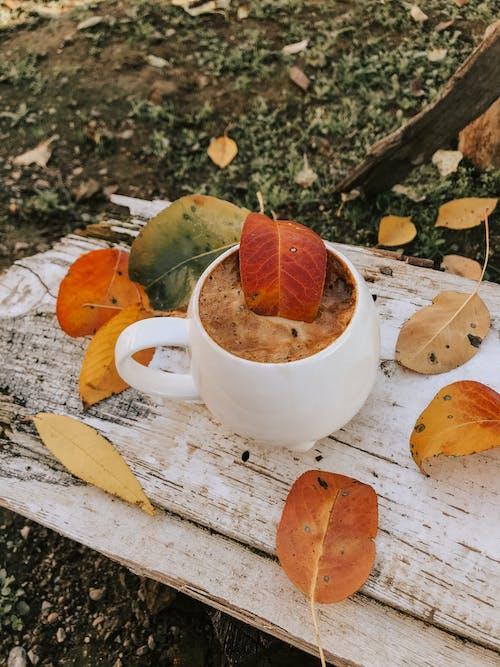 White Ceramic Teacup on White Wooden Table