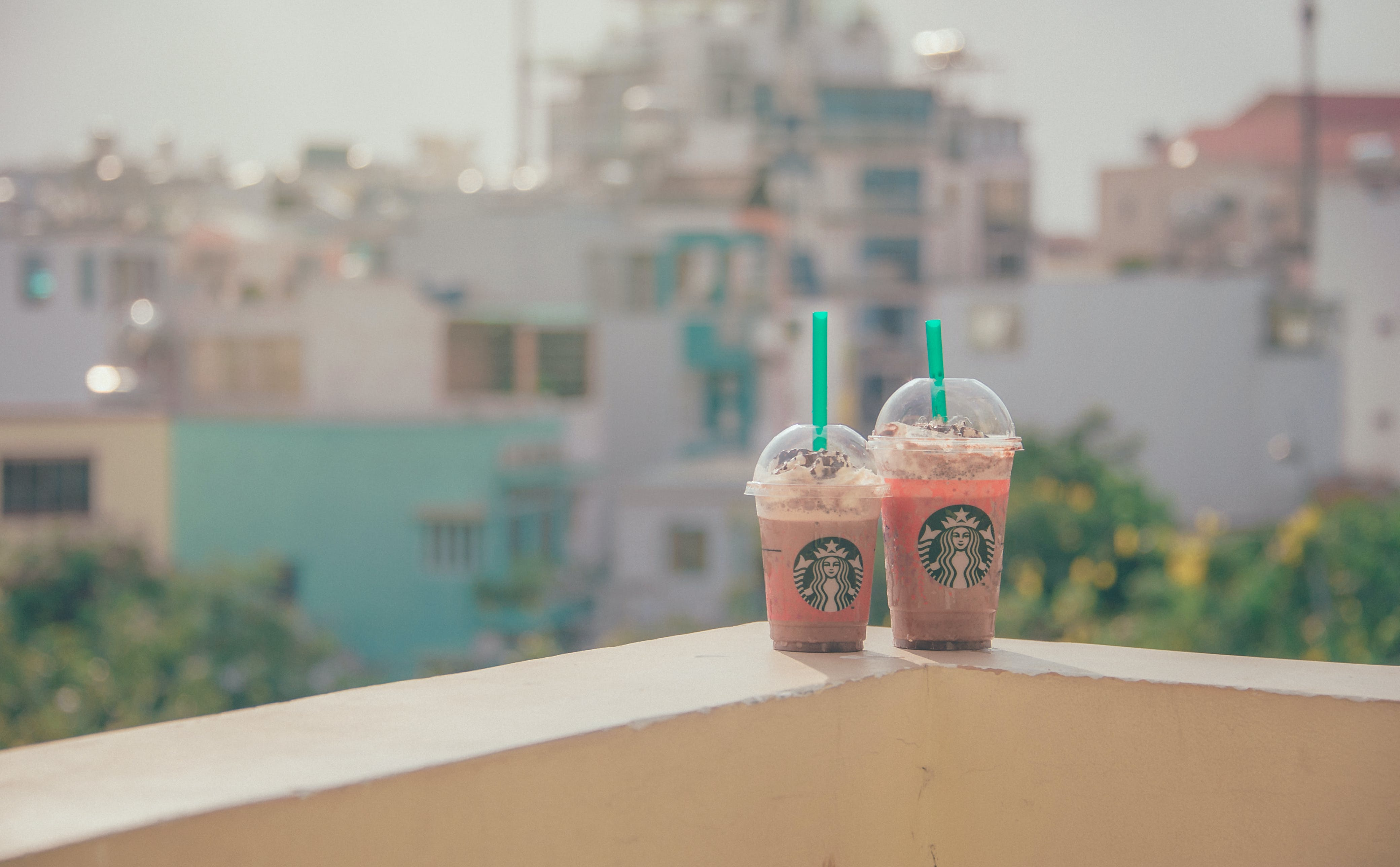 Close-Up Photography of Two Starbucks Disposable Cups