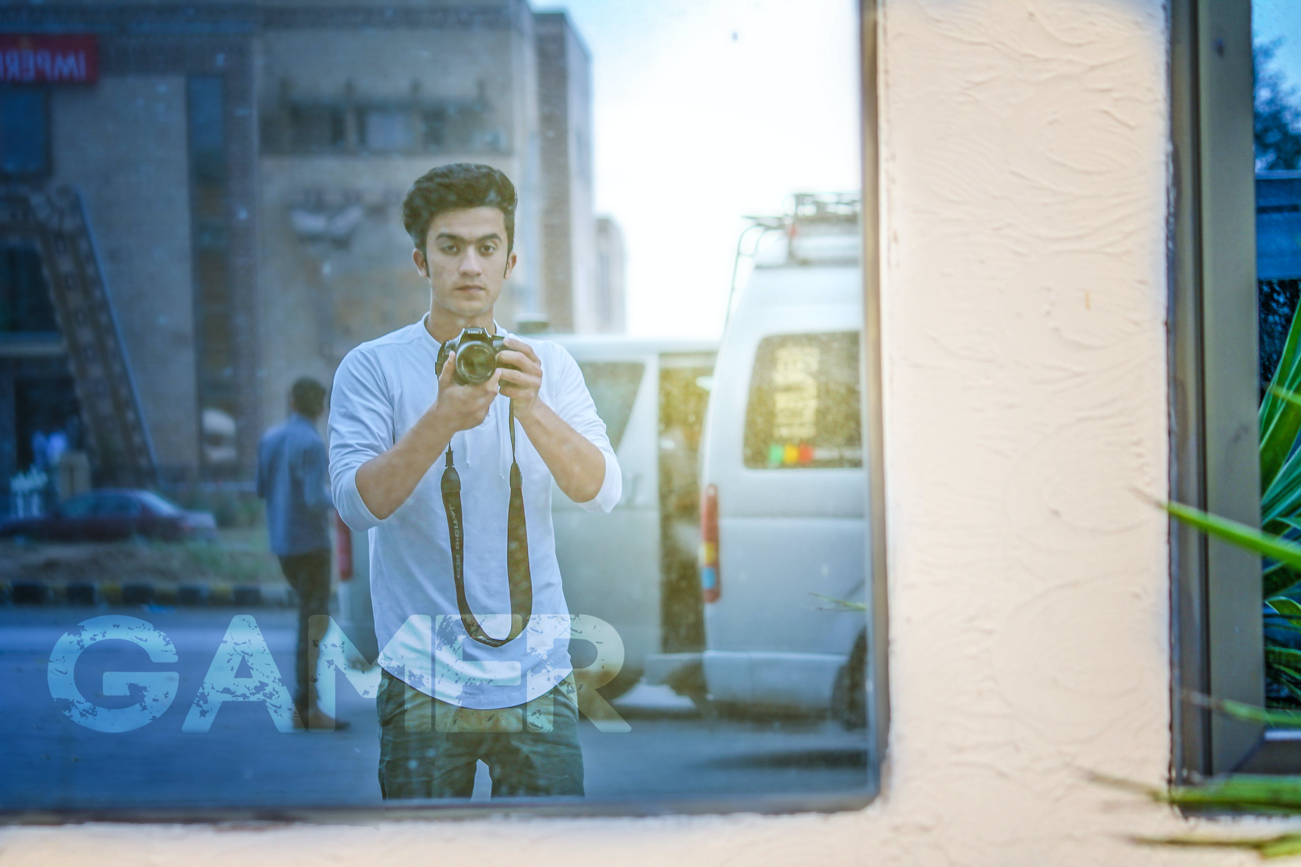 Man Wearing White Shirt And Holding Camera
