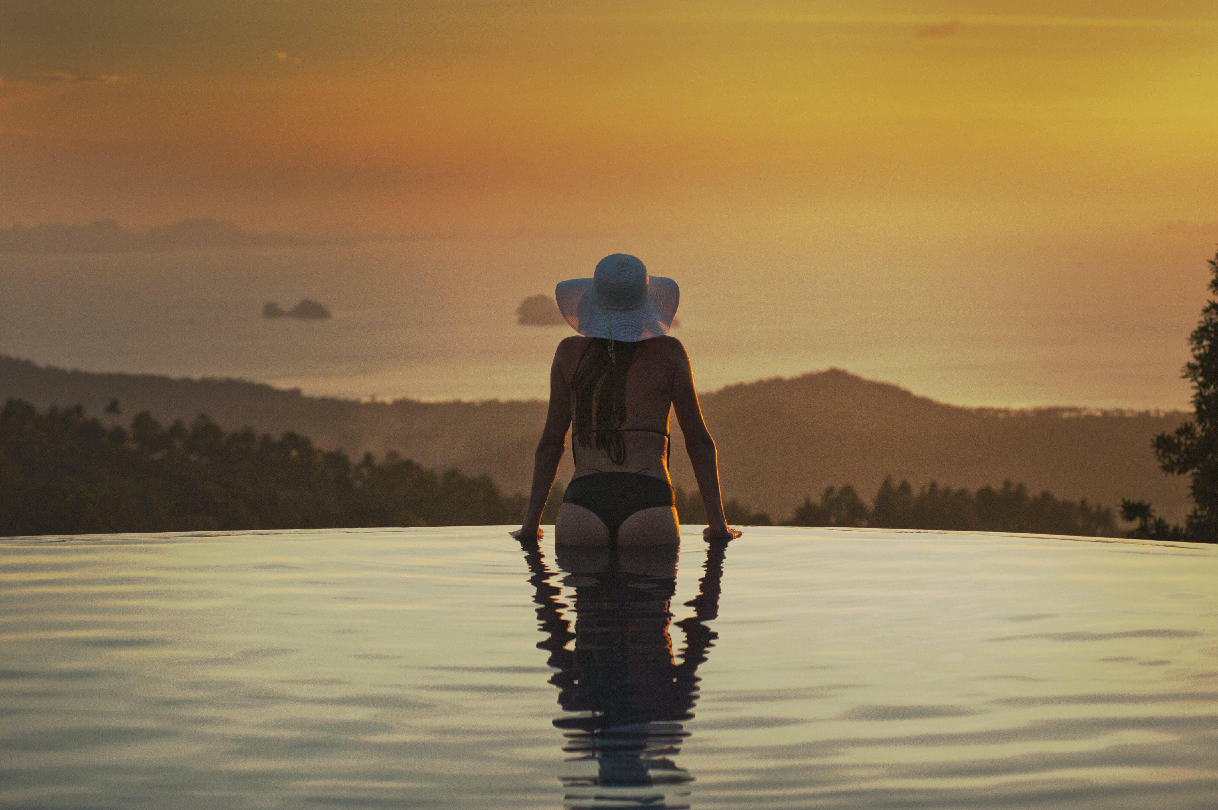 Woman At The Edge Of The Pool