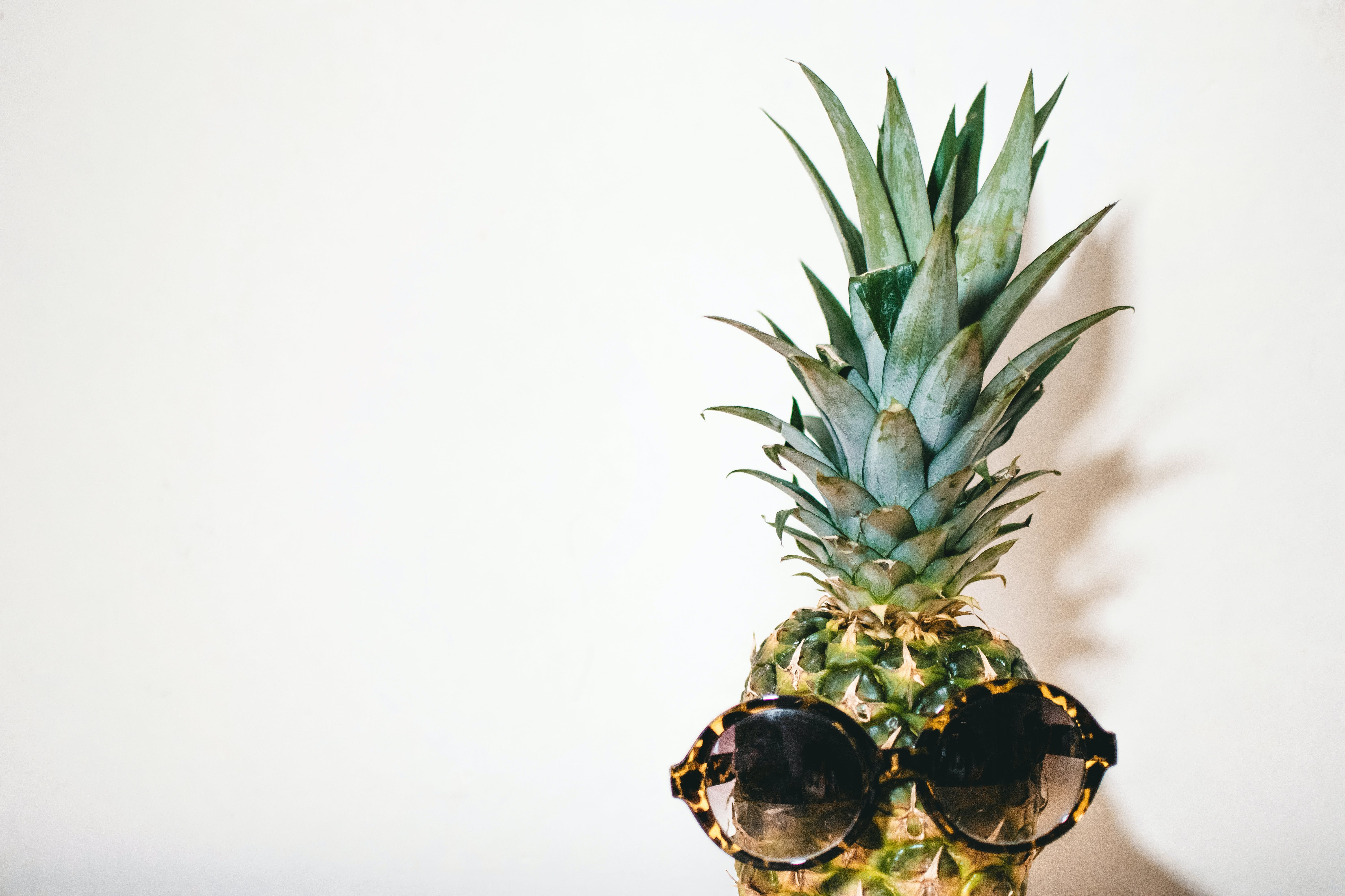 Close-Up Photography of Eyeglasses on Pineapple