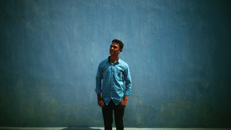 Free stock photo of blue, blue background, casual clothing, denim shirt
