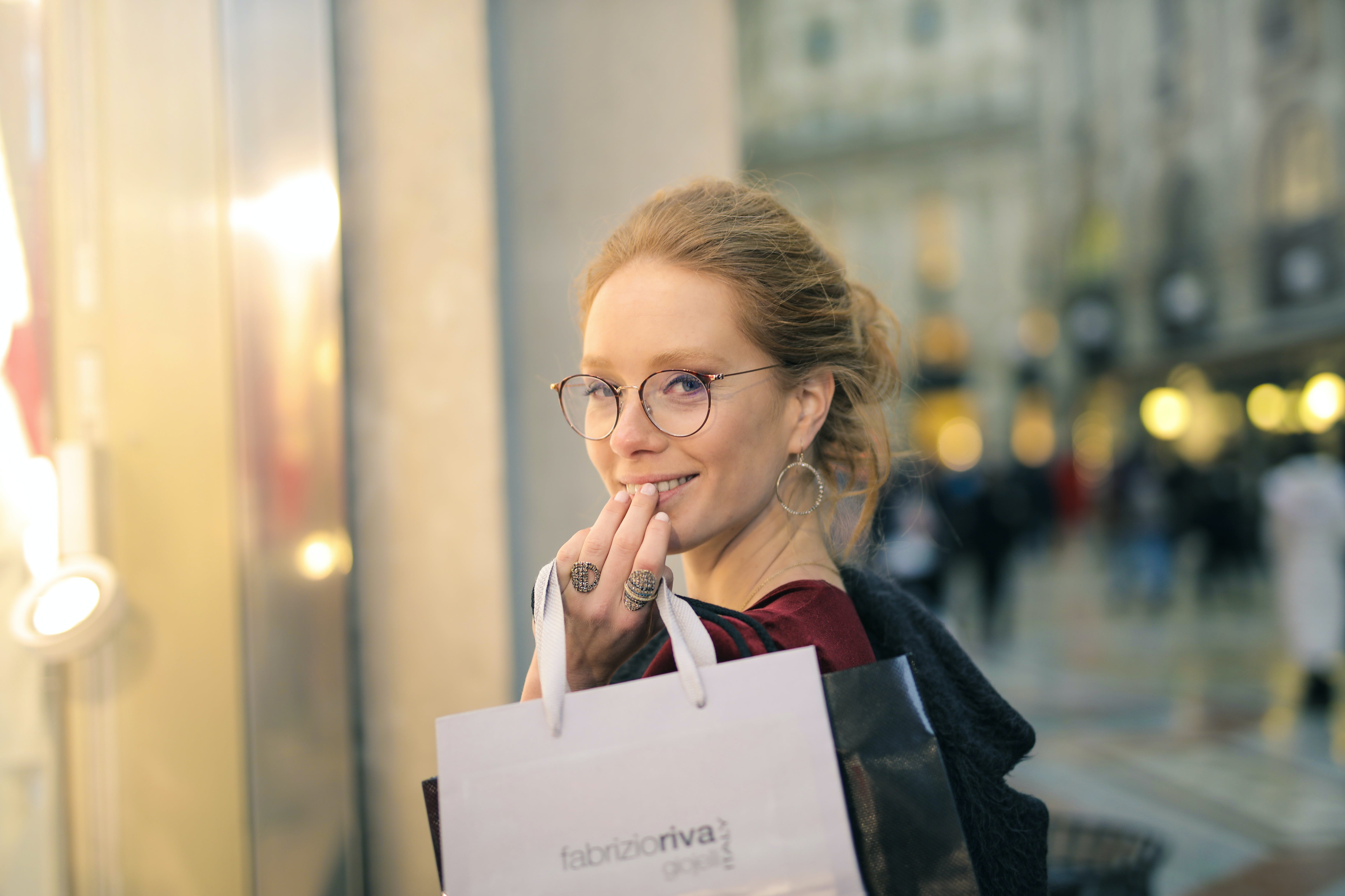 Close-Up Photography of a Woman Holding Paper Bags