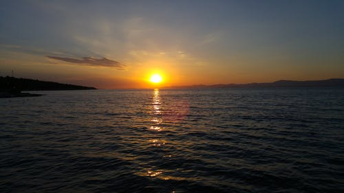 Fotos de stock gratuitas de agua, mar, naranja, nube
