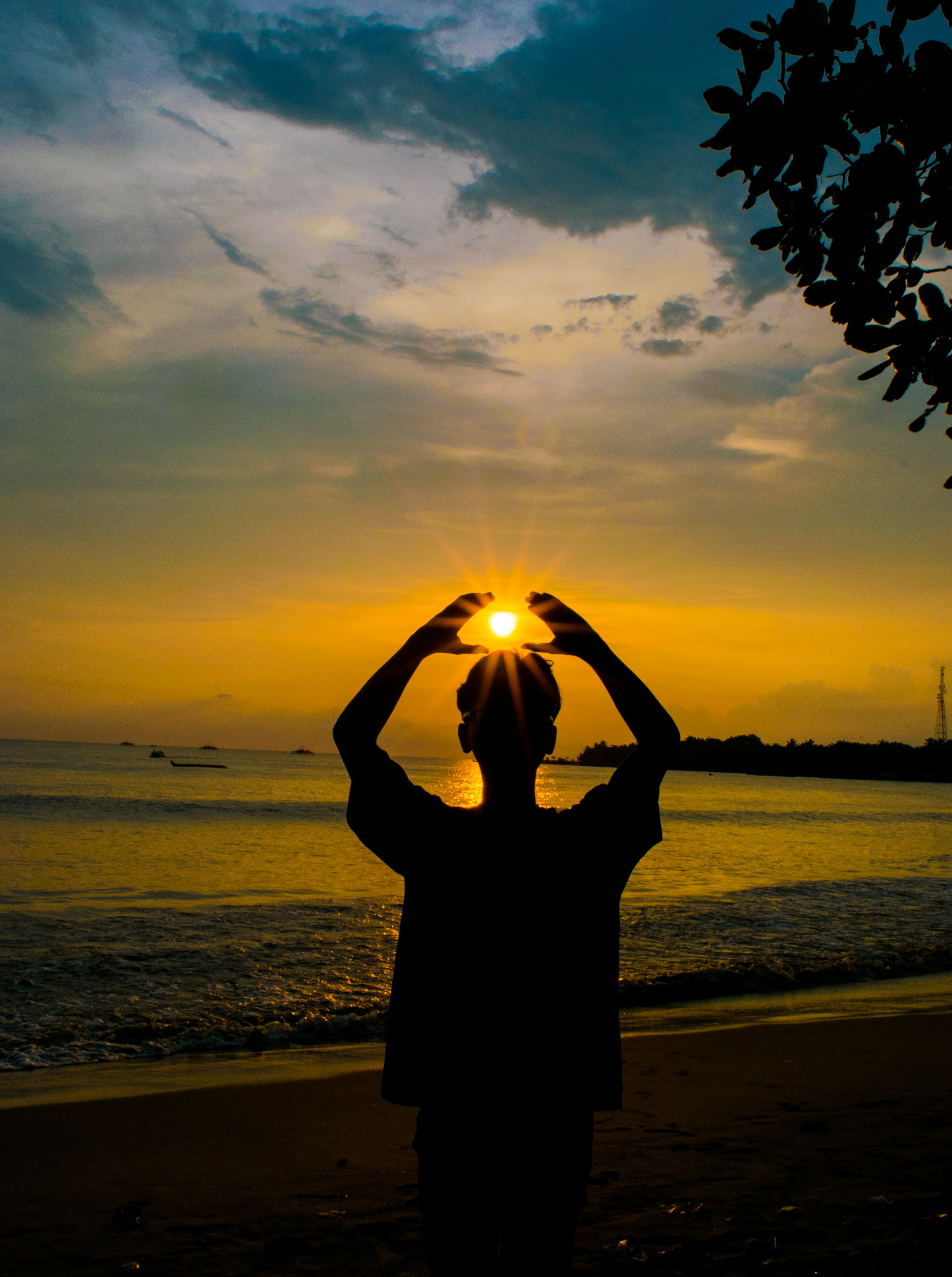 Silhouette Photo of Person Raising Hands