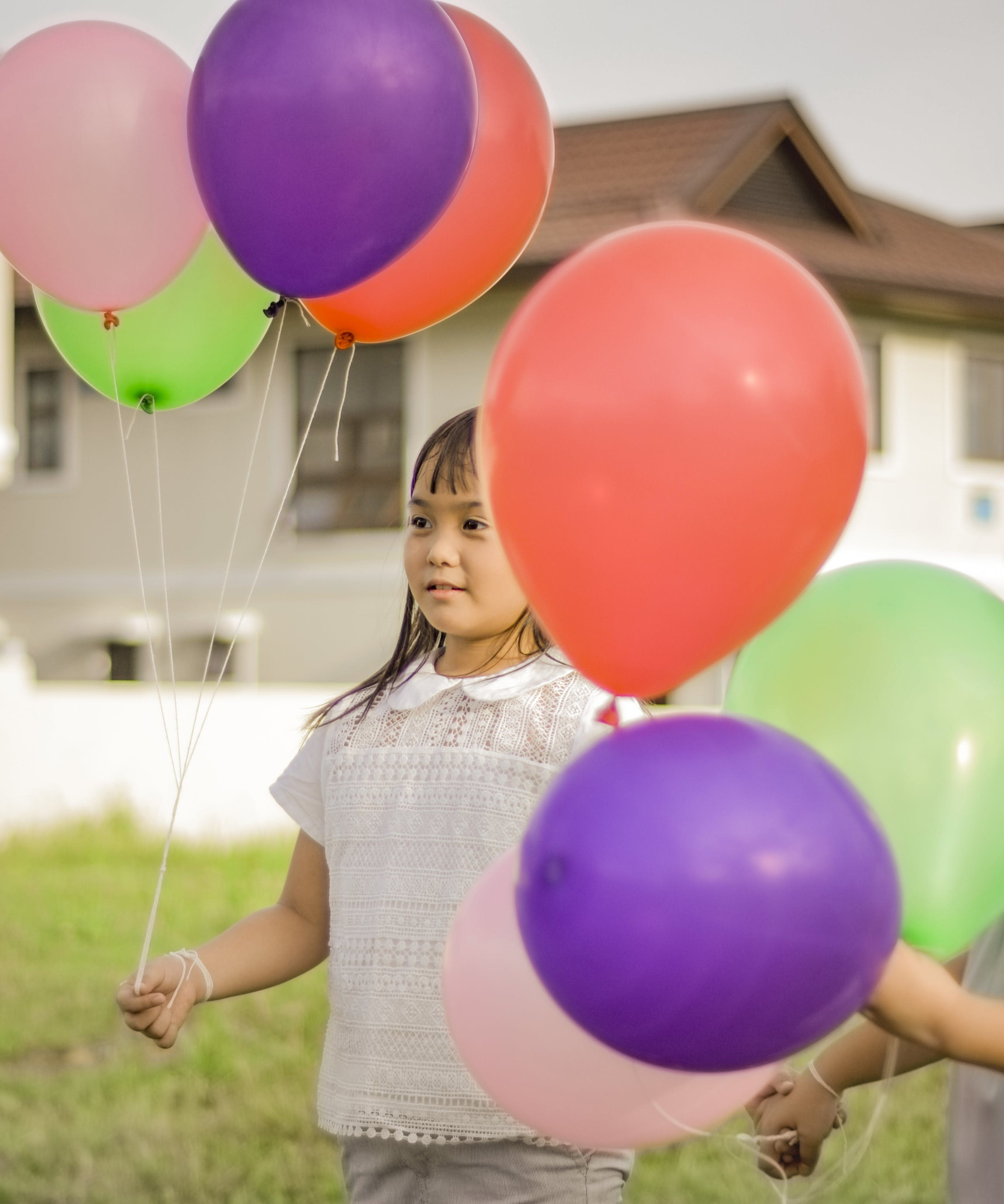 Photography of a Girl Holding Balloons